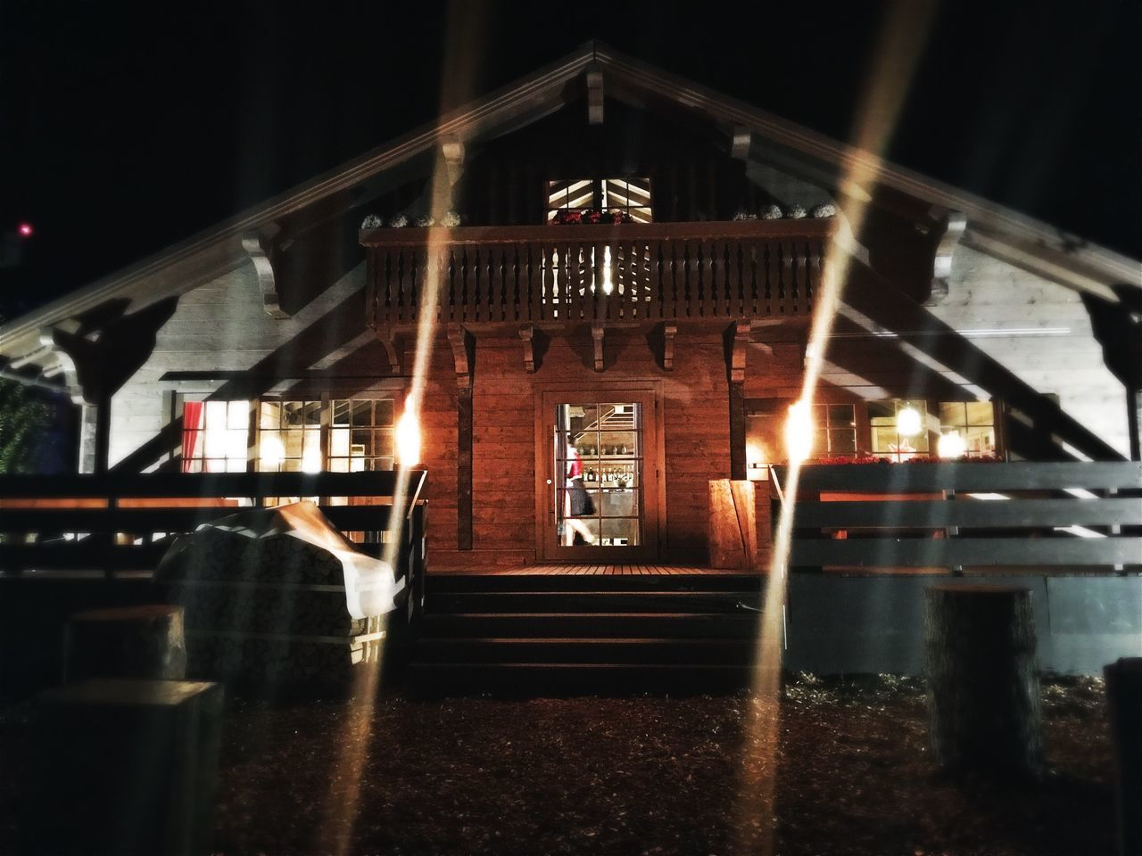 Illuminated Text Architecture Road Built Structure Building Exterior Night Steps Railroad Station Outdoors Entrance Sky Tourism Lens Flare Chalet
