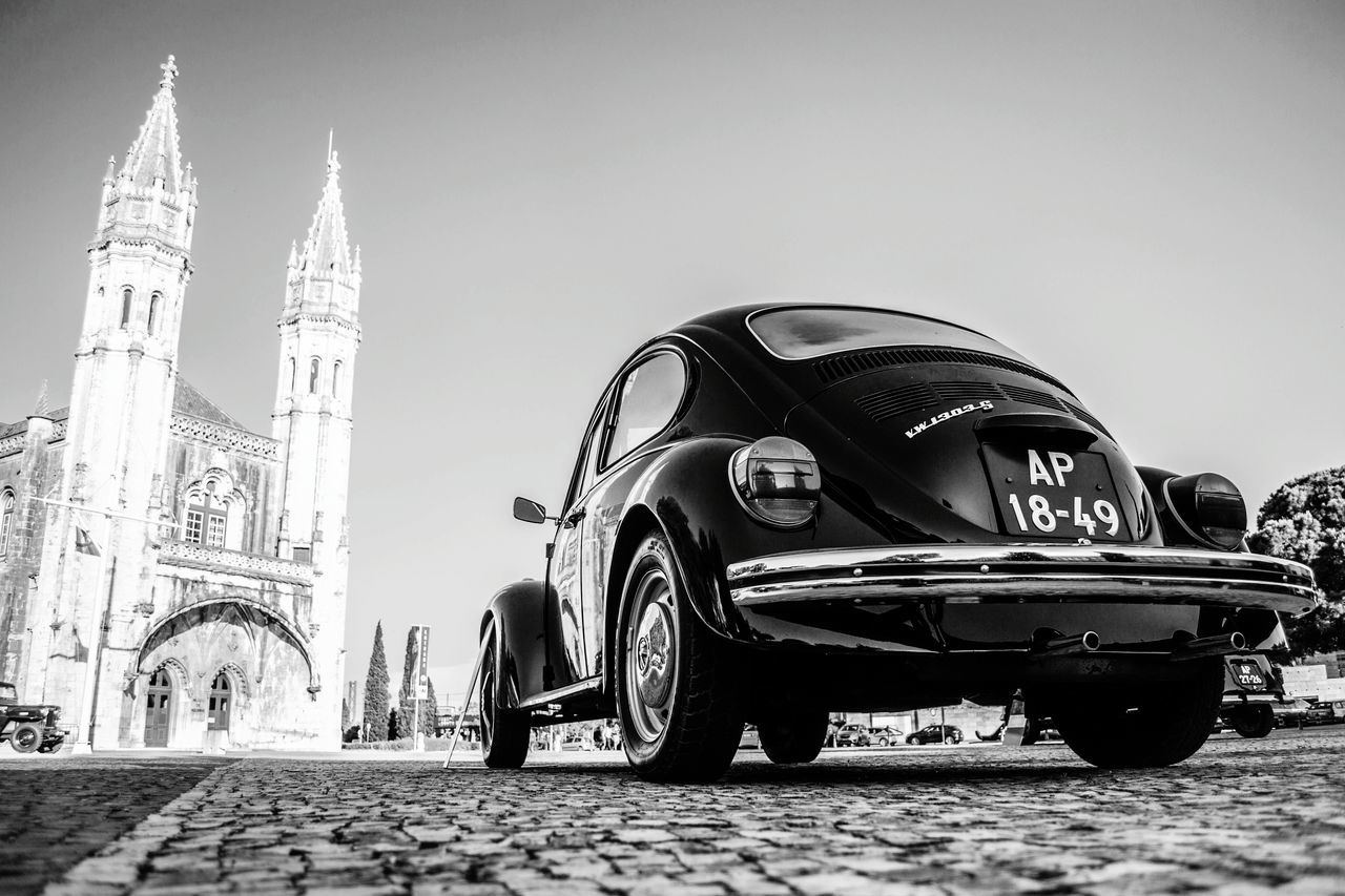 The old and the not-so-new. A Volkswagen Beetle sits near the Museu de Marinha in Lisbon, Portugal. Also seen in the photograph is a facade of the Mosteiro dos Jerónimos ( Jerónimos Monastery ). The Jerónimos Monastery is considered one of the most impressive symbols of Portugal's power and wealth during the Age of Discovery. It houses the tomb of Vasco da Gama. Close to the monastery one can find several other monuments and attractions showcasing Portuguese power and excellence, including the Tower of Belém and numerous museums. Do not forget to try out the delicious bakes at the Pastéis de Belém! Happy exploring :) Lisboa Lisbon Portugal Monastery Beetle EyeEmBestPics Vwbeetle Jeronimos Jeronimos Monastery Vwporn Travel Heritage Vasco Da Gama World History Wide Angle Explore EyeEm Best Shots Eyeem Lisbon Belém Black And White Contrast Historical Place Portugal History Wide Angle View From Below