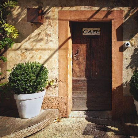 Plant Potted Plant No People Built Structure Day Text Building Exterior Outdoors Architecture Nature France Old Architecture Sunandshadow Streetscene Lourmarin En Provence