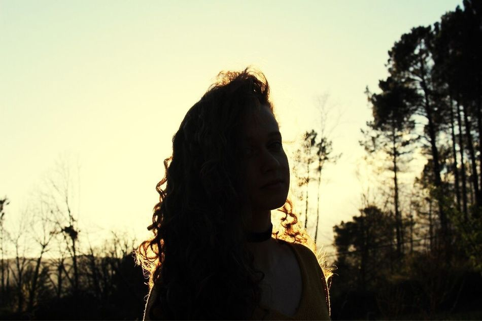 GALA Sunset Tree One Person Real People Silhouette Sky Long Hair Leisure Activity Headshot Focus On Foreground Outdoors Lifestyles Nature Clear Sky Standing Young Women Young Adult Beauty In Nature Day Close-up Spirituality Adult Shadow Lust For Life Legend