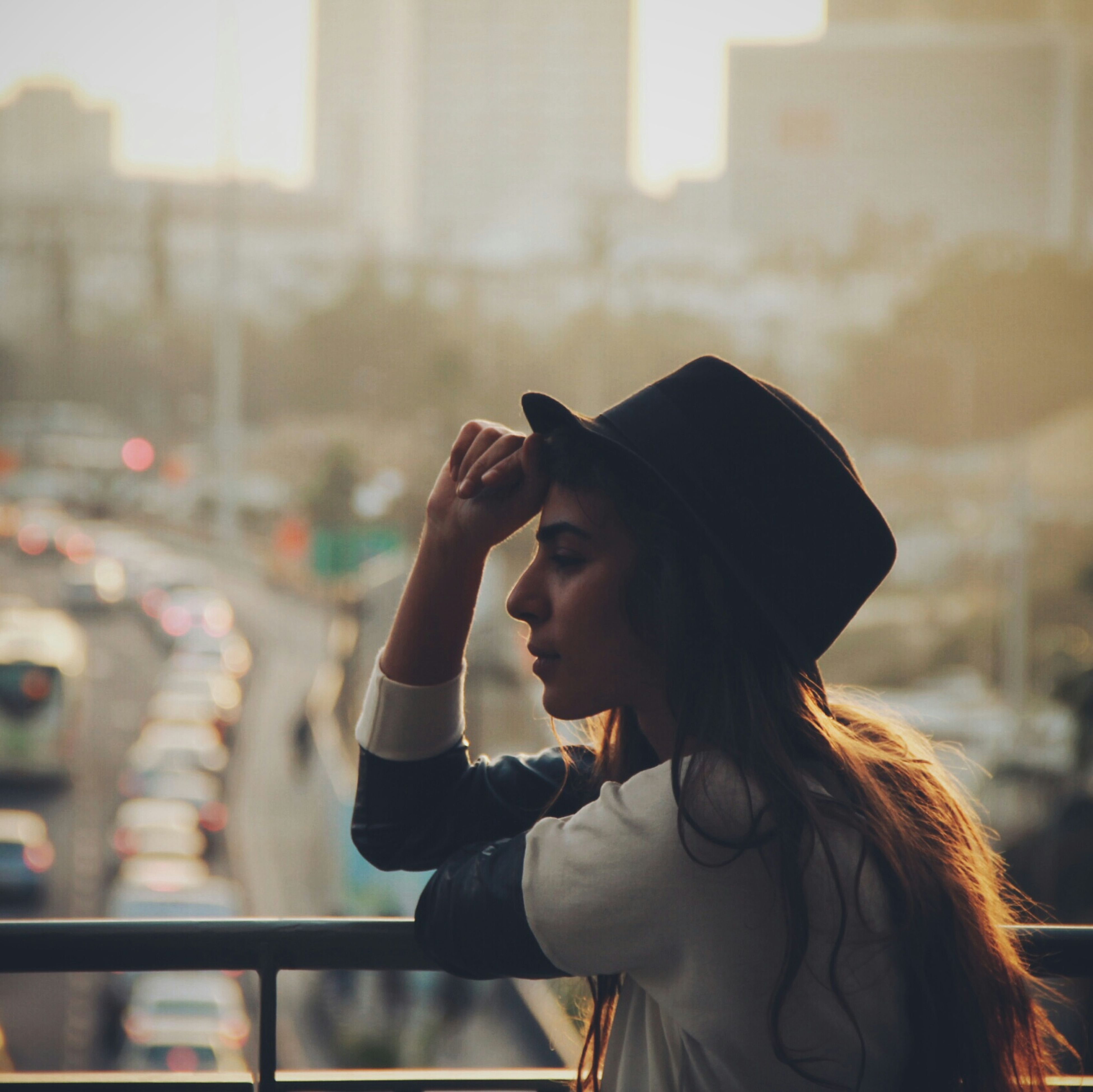 focus on foreground, lifestyles, headshot, waist up, leisure activity, young adult, holding, person, casual clothing, head and shoulders, looking away, side view, three quarter length, young women, rear view, sitting, long hair, photography themes