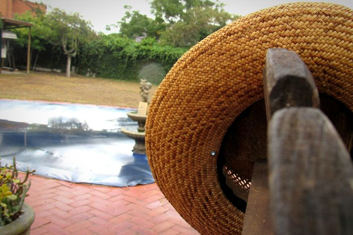 Straw hat not fit for a rainy day in PE. Water Swimming Pool Day No People Windy City Port Elizabeth Eyecatcher EyeEmNewHere Happiness Sky Rainy Days☔ Straw Hat Close Up Wooden Texture Red Brick Simplicity