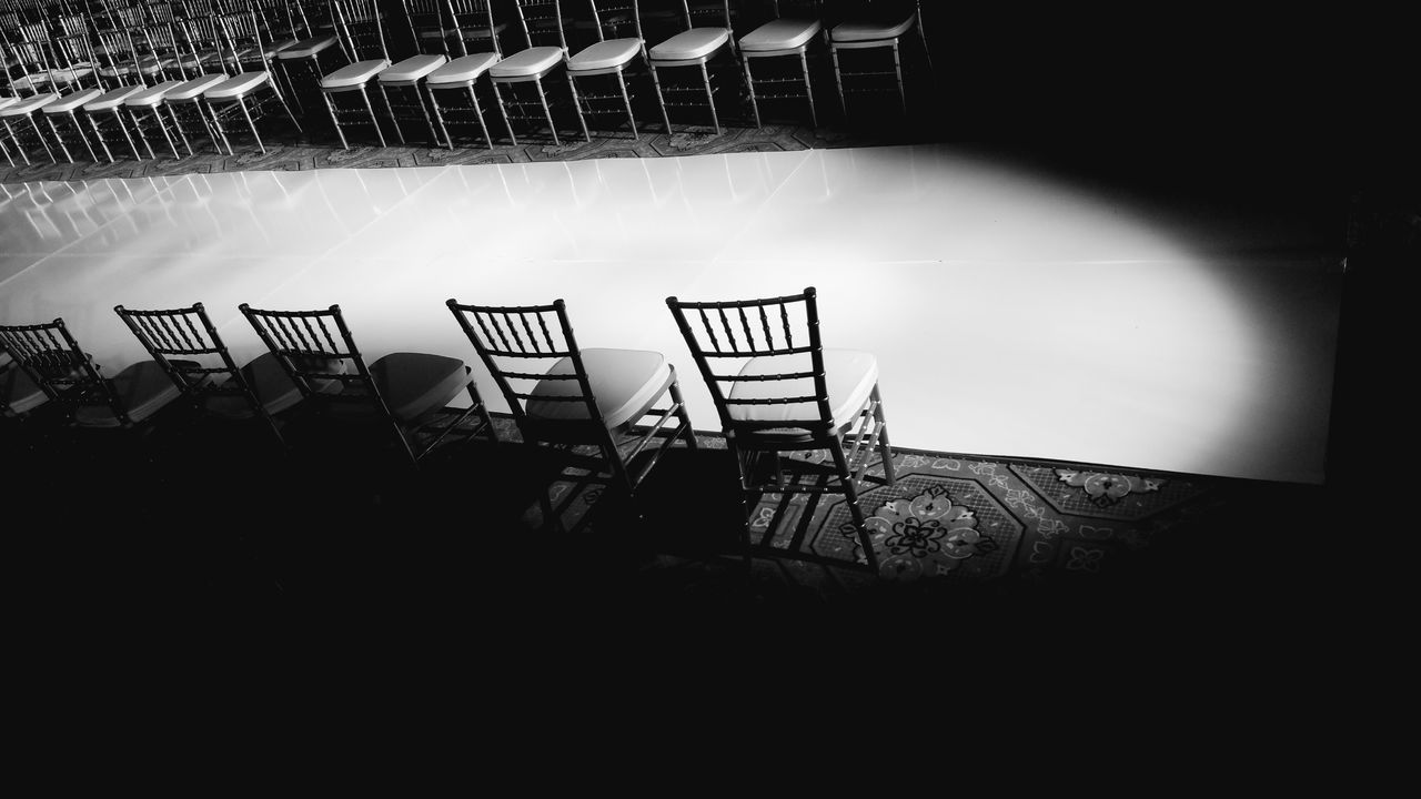 Indoor Photography Runway Spot Light  Chairs Black And White Collection  Black And White Photography No People Rowofchairs TheLight Walking Path