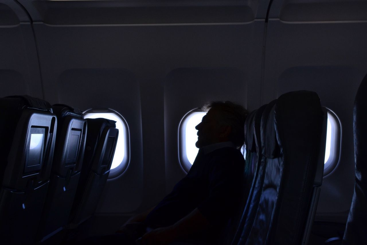 Light And Shadow Airplane Window Silhouette