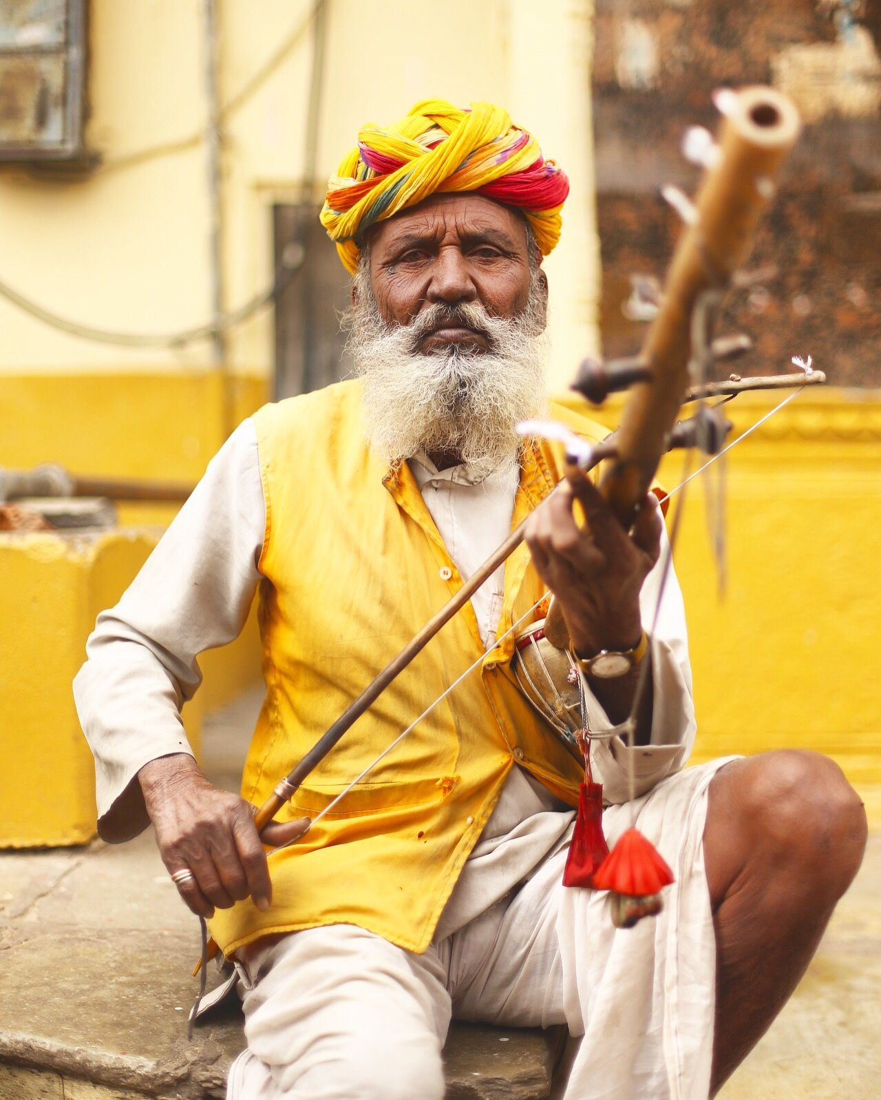 Uniqueness Potrait Beard Yellow One Person One Man Only Adults Only Turban Only Men Traditional Clothing People City Religion Adult Outdoors City Life Cultures Men Real People Jewelry Human Body Part Musical Instrument Old Age Music Musician