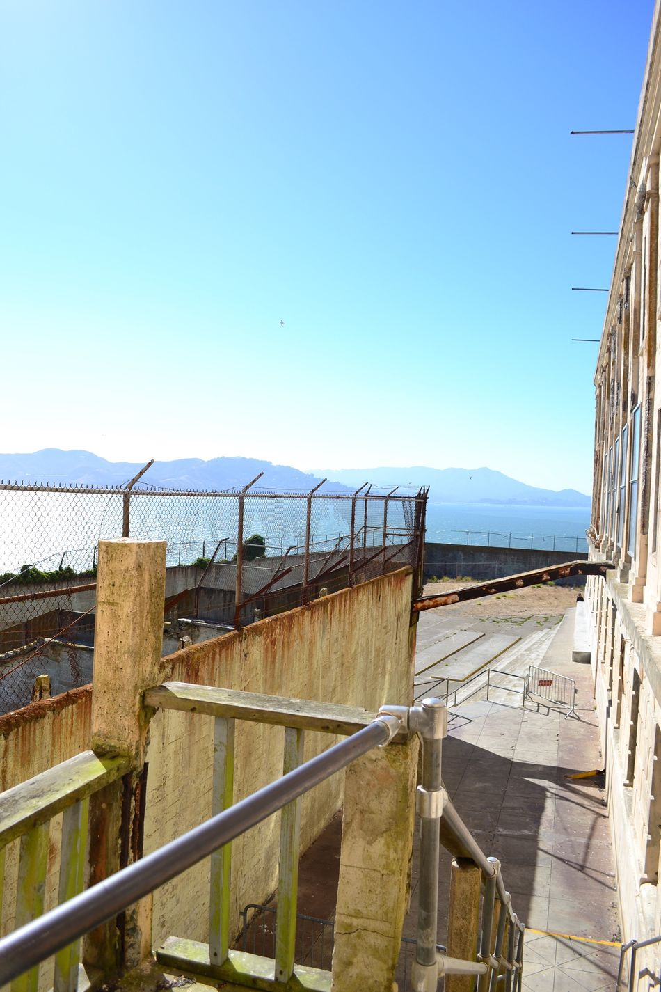 Built Structure Sea Blue Architecture Sunlight Water Clear Sky Railing Sky Day Outdoors No People Nature Building Exterior Scenics Tranquility Travel Destinations Horizon Over Water Bridge - Man Made Structure Beauty In Nature Nofilter SanFranciscoBay Sanfrancisco Alcatraz Prison