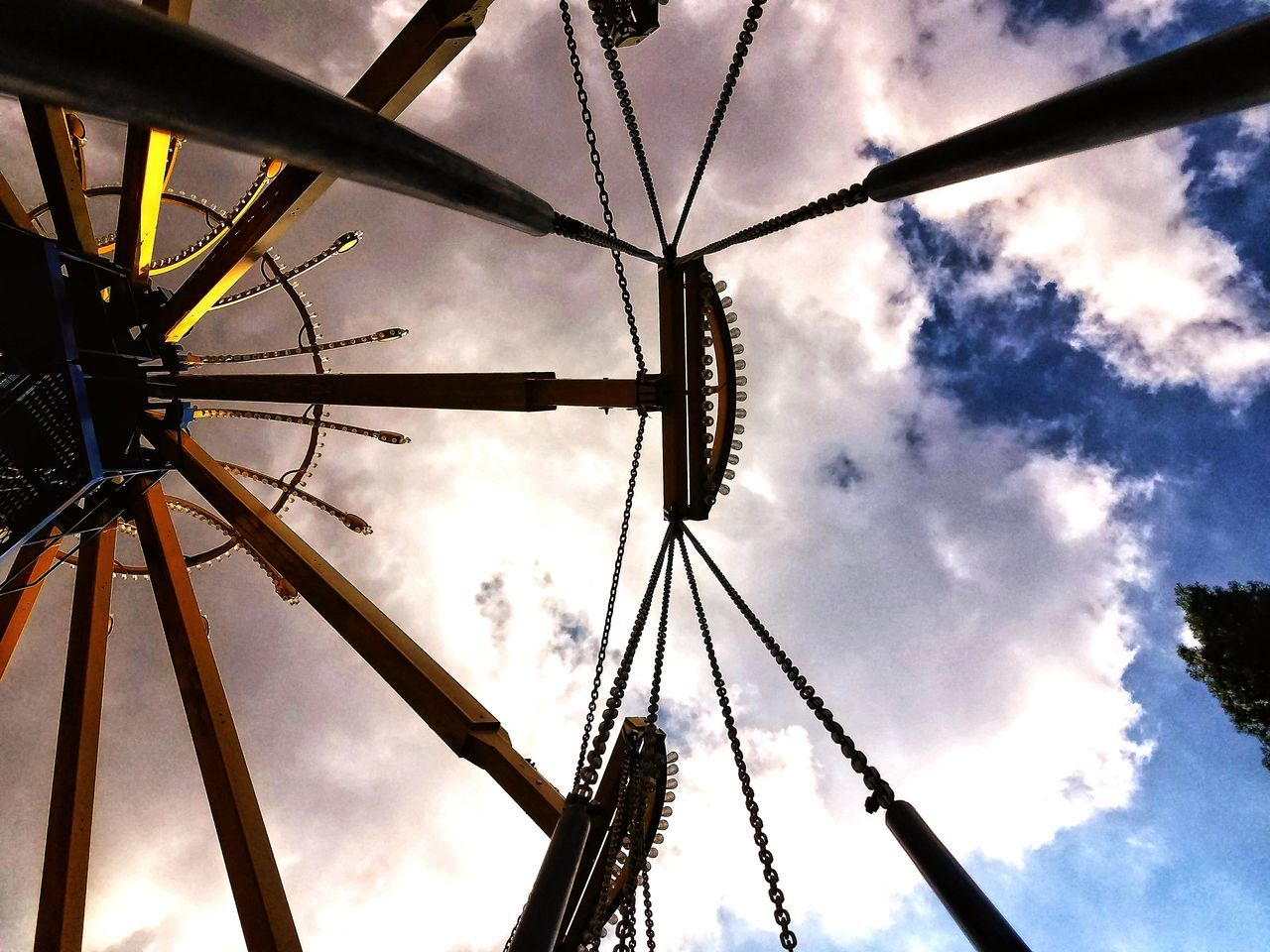 Looking up Swings Sky Low Angle View Arts Culture And Entertainment Cloud - Sky Amusement Park No People Amusement Park Ride Outdoors Day Close-up Nature Chains Rods Light Blub Lights Built_Structure Man Made Sky And Clouds Fun Times Magic Mountain Six Flags Magic Mountain