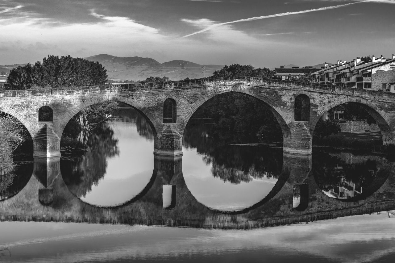 Bridge CaminodeSantiago Jakobsweg Puente La Reina SPAIN St James Way The Photojournalist - 2017 EyeEm Awards Pilgrimage Theway Photojournalism Stjamesway  Last Autumn (september/october 2016) I traveled alone to France and Spain to work on my Photography Documentary Project called Faces and Places of the Camino de Santiago. I walked the French Way, from Saint Jean Pied de Port(France) to Santiago de Compostela (Spain), more than 800 km with my backpack and my Camera. The project was to photograph the Camino and the Pilgrims with a Pilgtim's Eyes. My goal with this project was not to photograph monuments or lsndscspes, all I tried to photograph was the mood and the spirit of the Camino. The project in a near future is to turn into a Photography book that willl be called The Ride - A Photographer's Journey thru the Camino de Santiago! Hope you all enjoy the Ride thru my images....