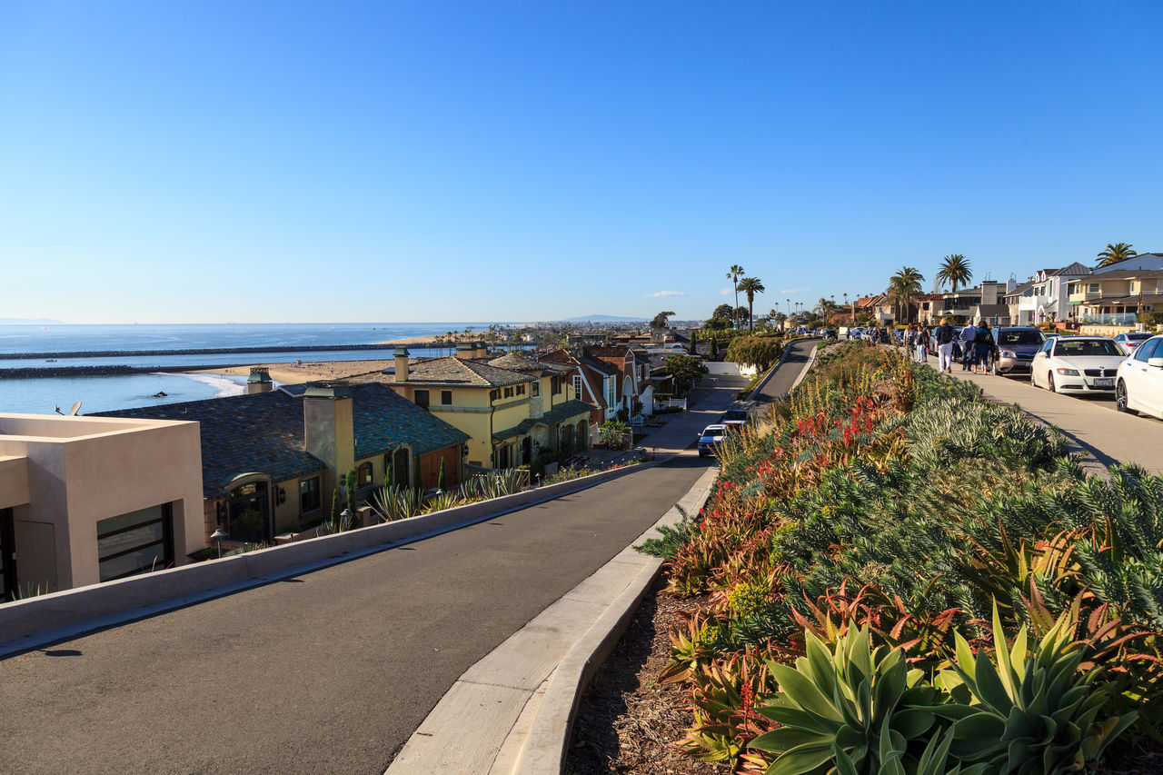 Fancy beach homes along Corona del Mar beach coastline in Southern California Architecture Beach Beach Homes City Clear Sky Corona Del Mar Day Horizon Over Water Newport Beach, CA, USA No People Outdoors Sea Sky Travel Destinations