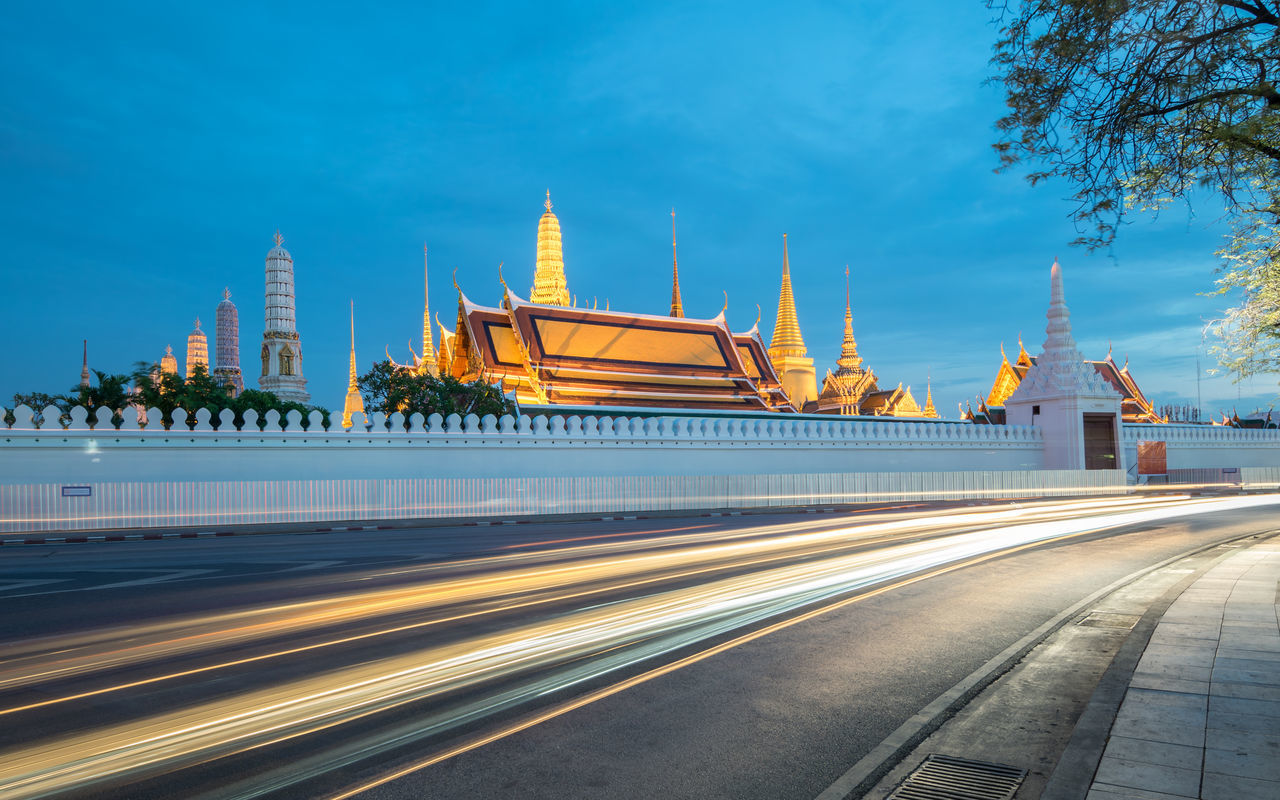 Wat Phra-kaew with long trail of traffic light in bangkok , thailand at twilight time Bangkok Bangkok Thailand. Capital Cities  City Grand Place Light Trail No People Outdoors Sky Tourism Travel Destinations Wat Phra Kaew