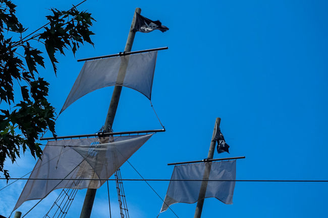 Bell Blue Blue Sky Clear Sky Day Flag High Section Low Angle View No People Outdoors Pirate Pirate Ship Pirates Pirateship  Pole Renewable Energy Sky Tall - High Weather Vane Windmill