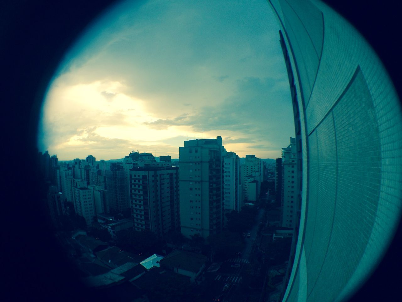 architecture, skyscraper, building exterior, city, cityscape, built structure, modern, no people, sky, tall, fish-eye lens, outdoors, urban skyline, day, close-up