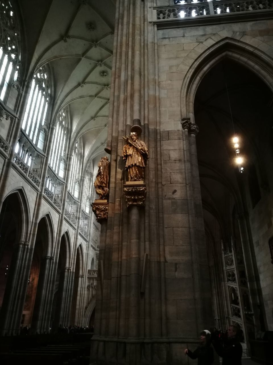 place of worship, religion, spirituality, architecture, statue, low angle view, built structure, sculpture, arch, history, travel destinations, indoors, architectural column, building exterior, day, no people