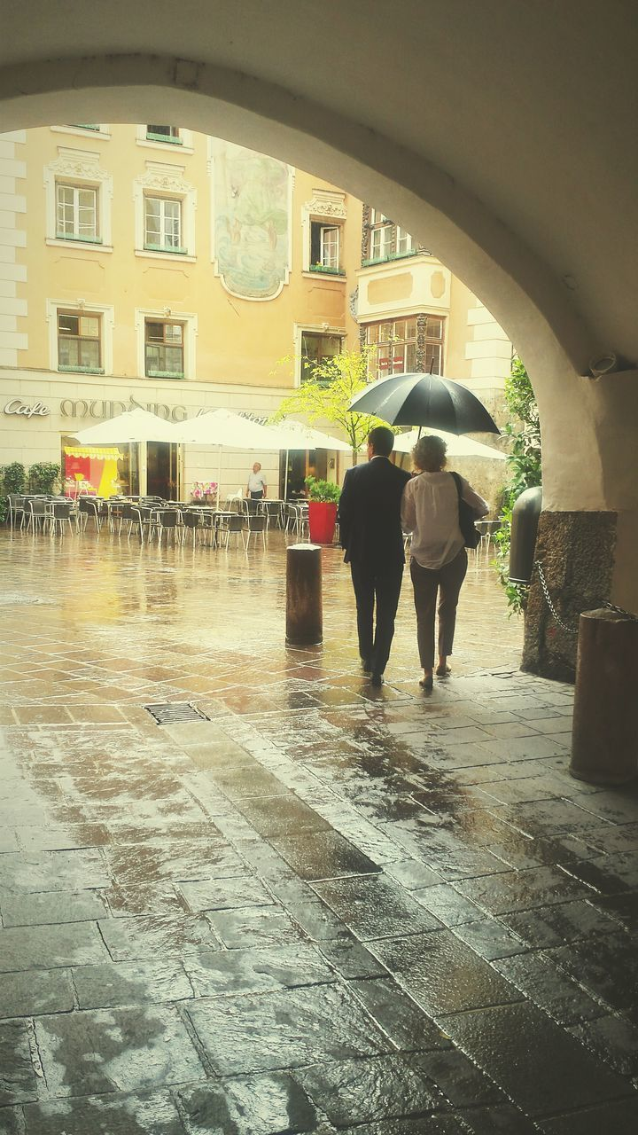 real people, wet, full length, rear view, two people, built structure, architecture, togetherness, lifestyles, men, water, women, day, under, building exterior, friendship, indoors, people