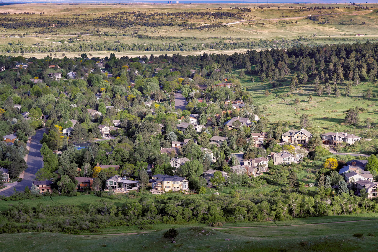 All the shades of green... Residential area and parkland open space. Boundary Buildings Day Development Flying High Green High Angle View Homes Houses Land Landscape Neighborhood Open Space Outdoors Parkland Residential District Scenics Town Trail Trees Streets