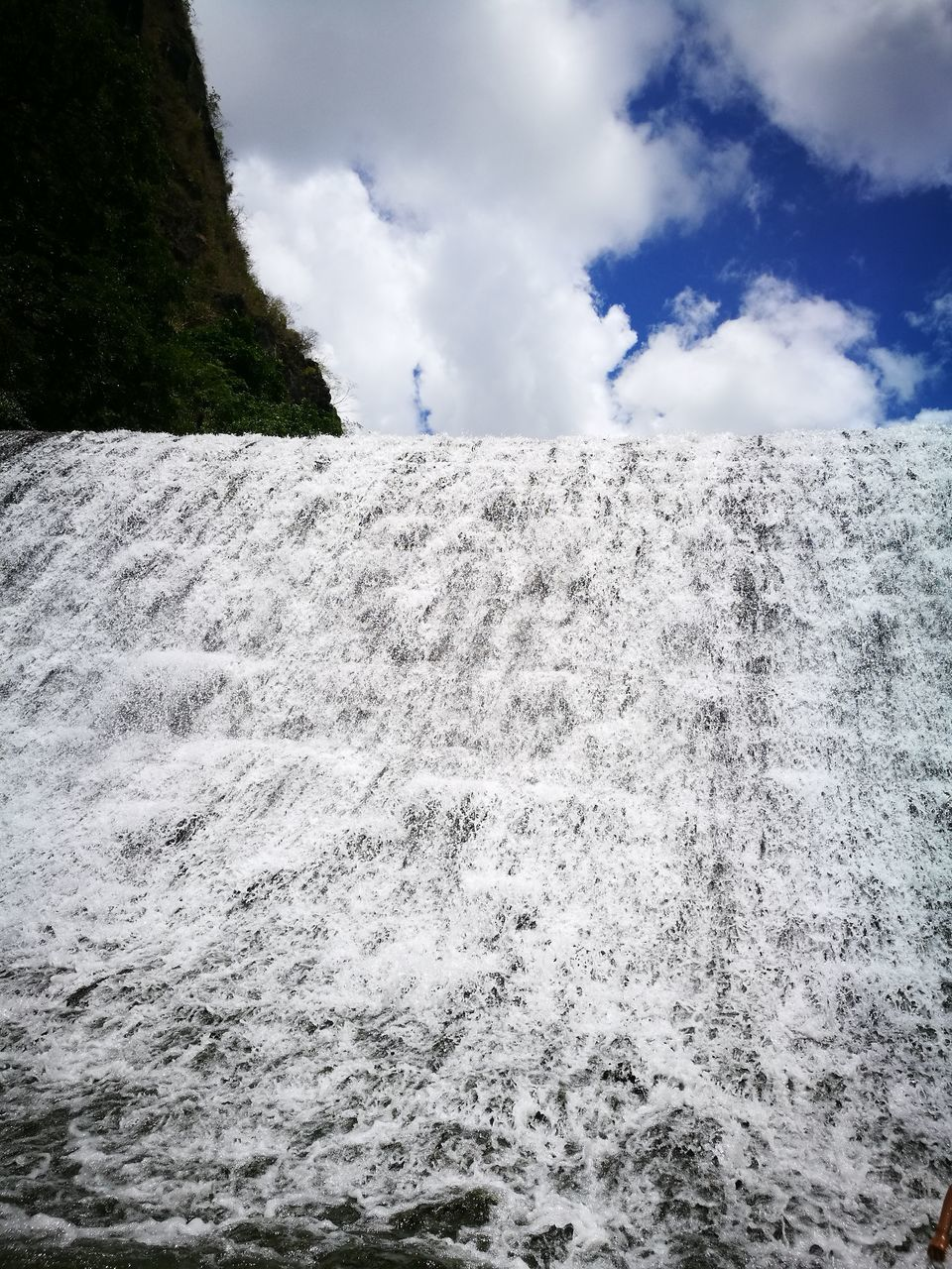 sky, cloud - sky, nature, beauty in nature, outdoors, scenics, motion, day, water, no people, tranquil scene, tranquility, steam, landscape, power in nature, waterfall, hot spring, spraying, tree