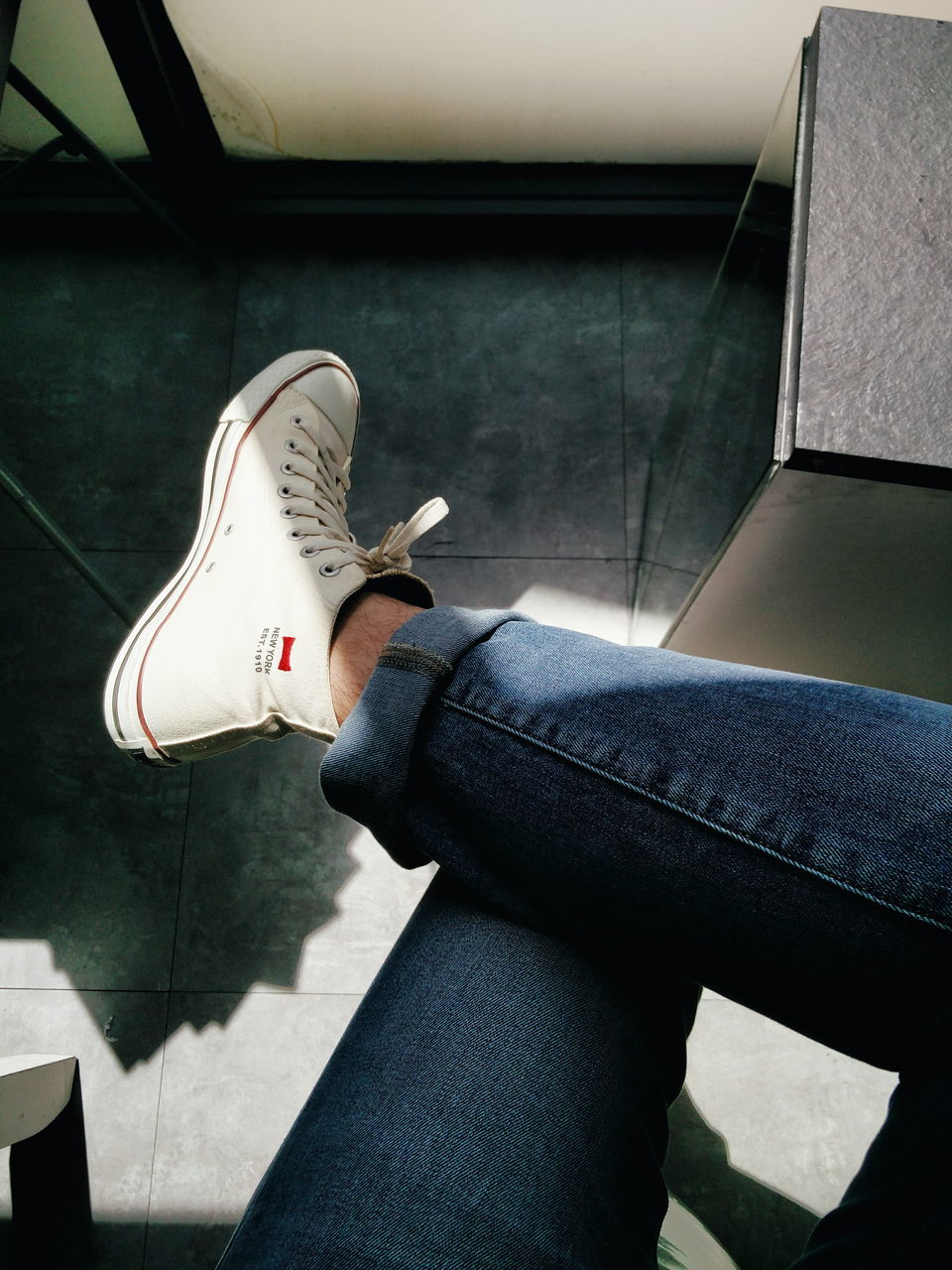 low section, human leg, real people, one person, jeans, shoe, indoors, casual clothing, human body part, leisure activity, lifestyles, day, women, men, sitting, standing, close-up, human hand, people