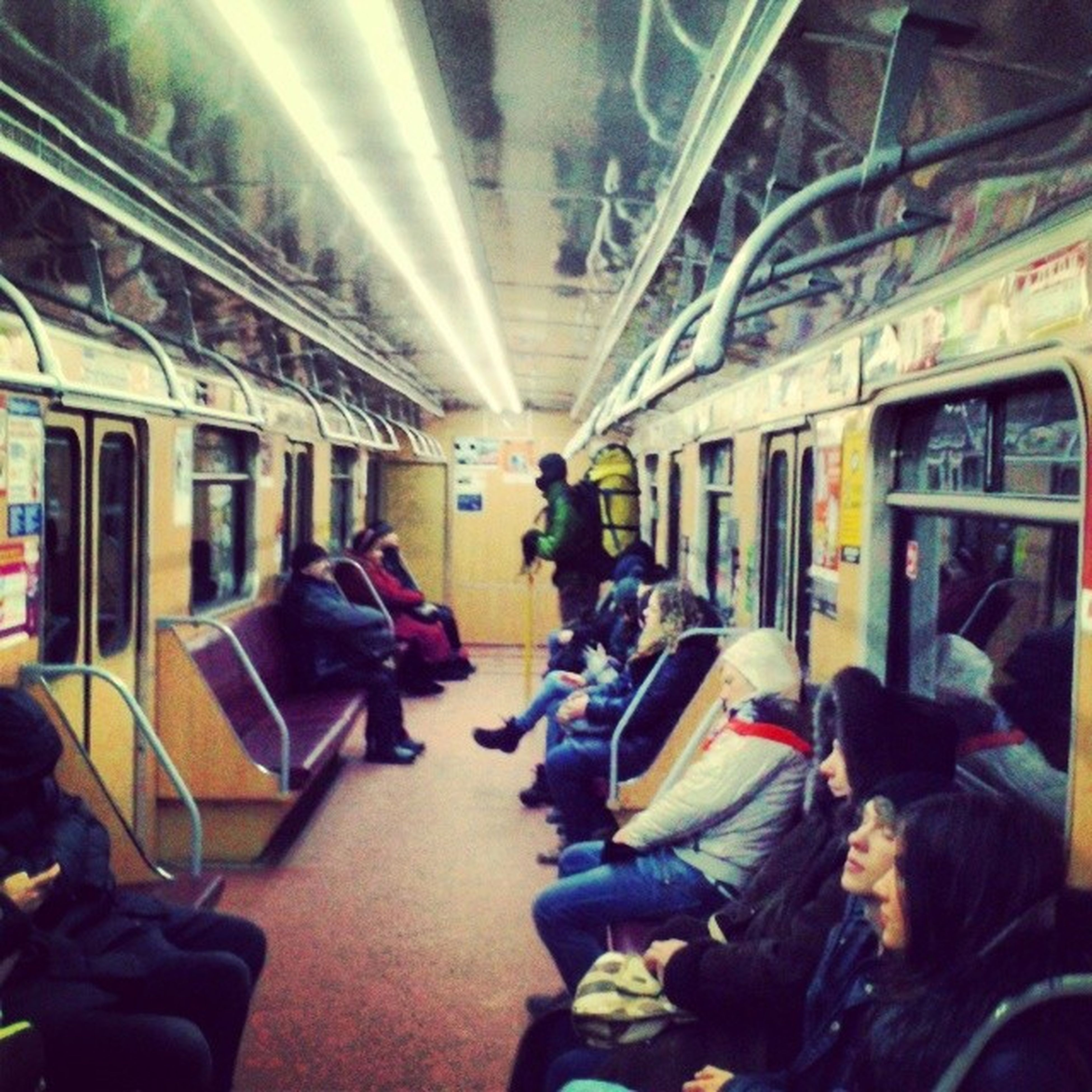 men, indoors, lifestyles, person, leisure activity, transportation, large group of people, public transportation, mode of transport, rear view, travel, medium group of people, architecture, passenger, walking, built structure, journey, vehicle interior