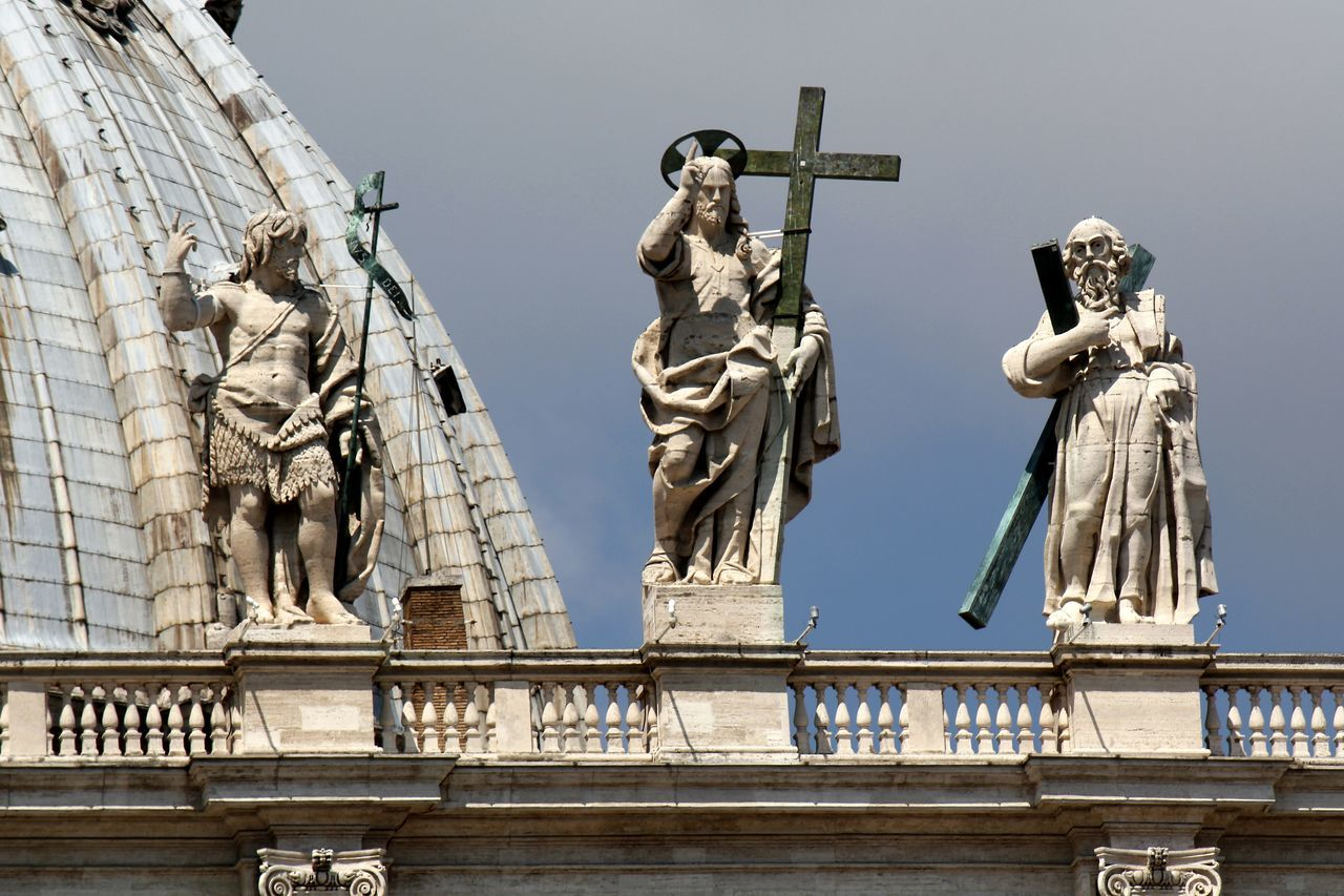 Statues on the roof of St Peters Basilica, the Vatican Rome Architecture Art And Craft Building Exterior Built Structure Catholic Christianity Day Historical Building History Human Representation Italy Low Angle View Male Likeness No People Outdoors Religion Rome Italy Sculpture Sky Spirituality Statue Tourism Travel Travel Destinations Vatican City