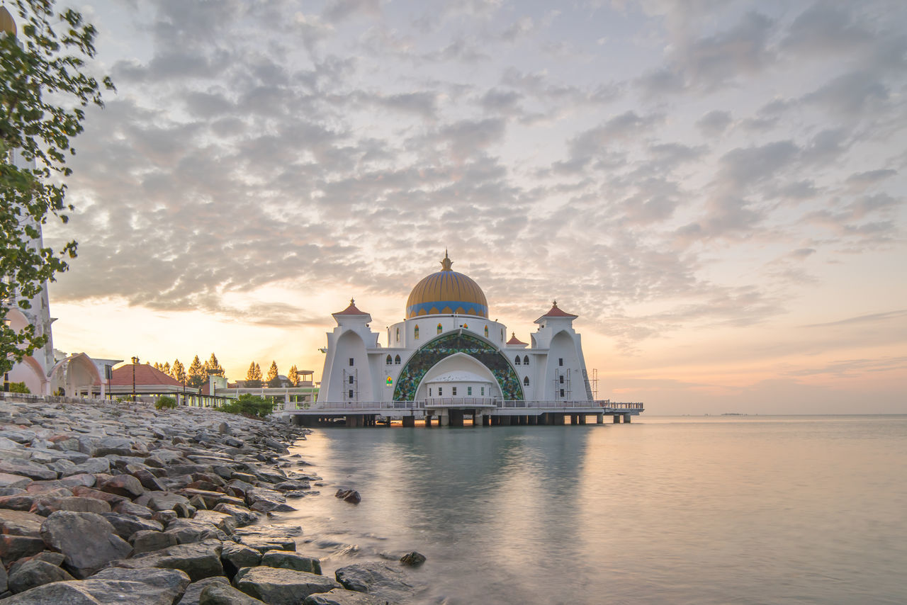 dome, religion, architecture, place of worship, built structure, spirituality, building exterior, sky, sunset, cloud - sky, water, outdoors, travel destinations, no people, day, nature