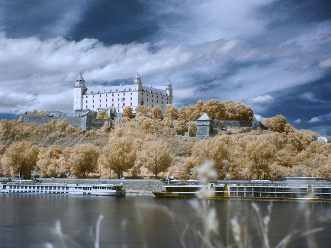true infeared Castle Bratislava, Slovakia Danube River Water Riverside Ships Teavel Destination Travel Blue Sky Clouds Infrared Infrared Photography Trees Old City Historical Building History Architecture History Architecture No People Day City Capital City Paint The Town Yellow