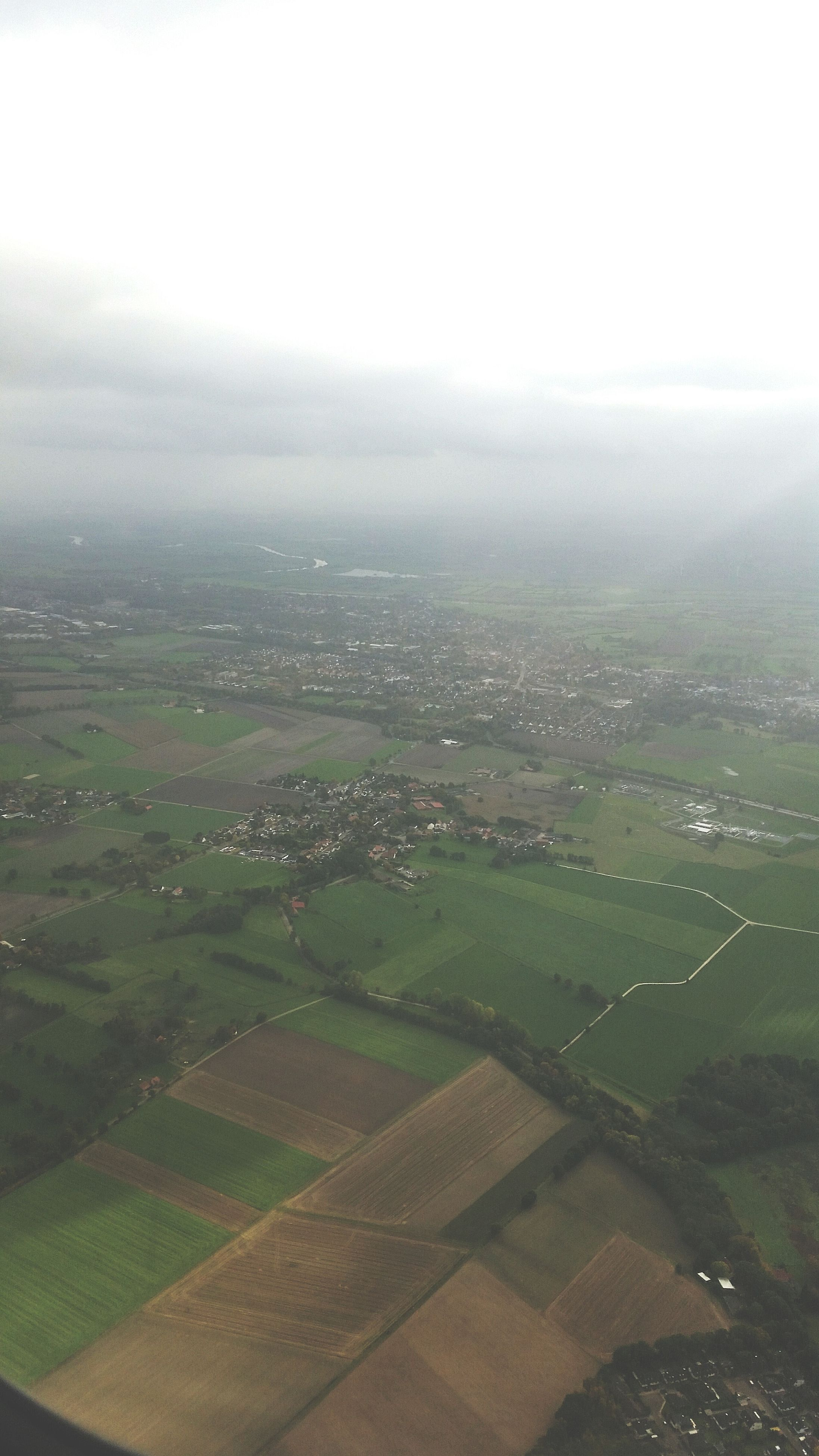 landscape, fog, aerial view, foggy, scenics, field, beauty in nature, nature, tranquility, tranquil scene, high angle view, green color, sky, day, weather, no people, built structure, outdoors, rural scene