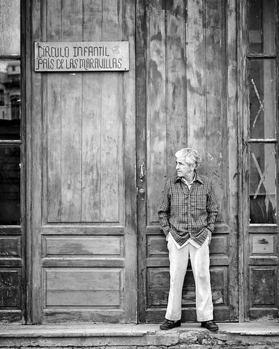 Land of the miracles. a Grandfather is waiting for his Grandchild. Wonderland Pais De Las Maravillas Cuba Street Black & White Black And White Streetphotography Showcase July Berlin Photographer Street Photography Found On The Roll The Week Of Eyeem Havana Viva Cuba! Streetphoto_bw Blackandwhite Monochrome Snap A Stranger