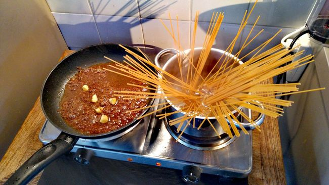 ShareTheMeal Preparation  Man Made Object Spiced Up Colors And Patterns Homemade Cooking High Angle View Indoors  Food Red Food And Drink Pan Boiling Water Tomato Ragutoscano Spaghetti Bolognese