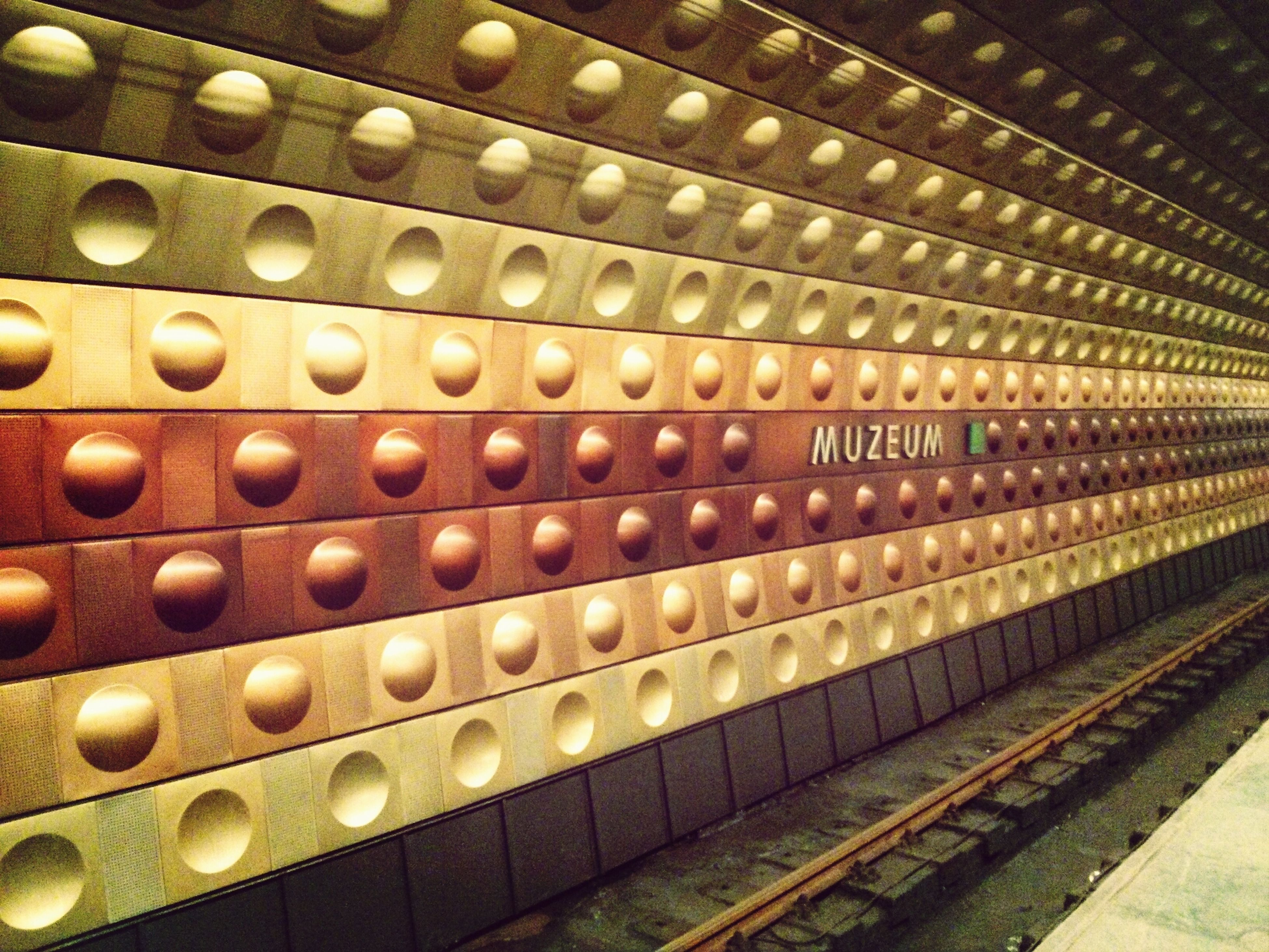 indoors, metal, full frame, backgrounds, metallic, in a row, repetition, pattern, no people, high angle view, technology, railroad track, close-up, transportation, rail transportation, public transportation, large group of objects, connection, day, number