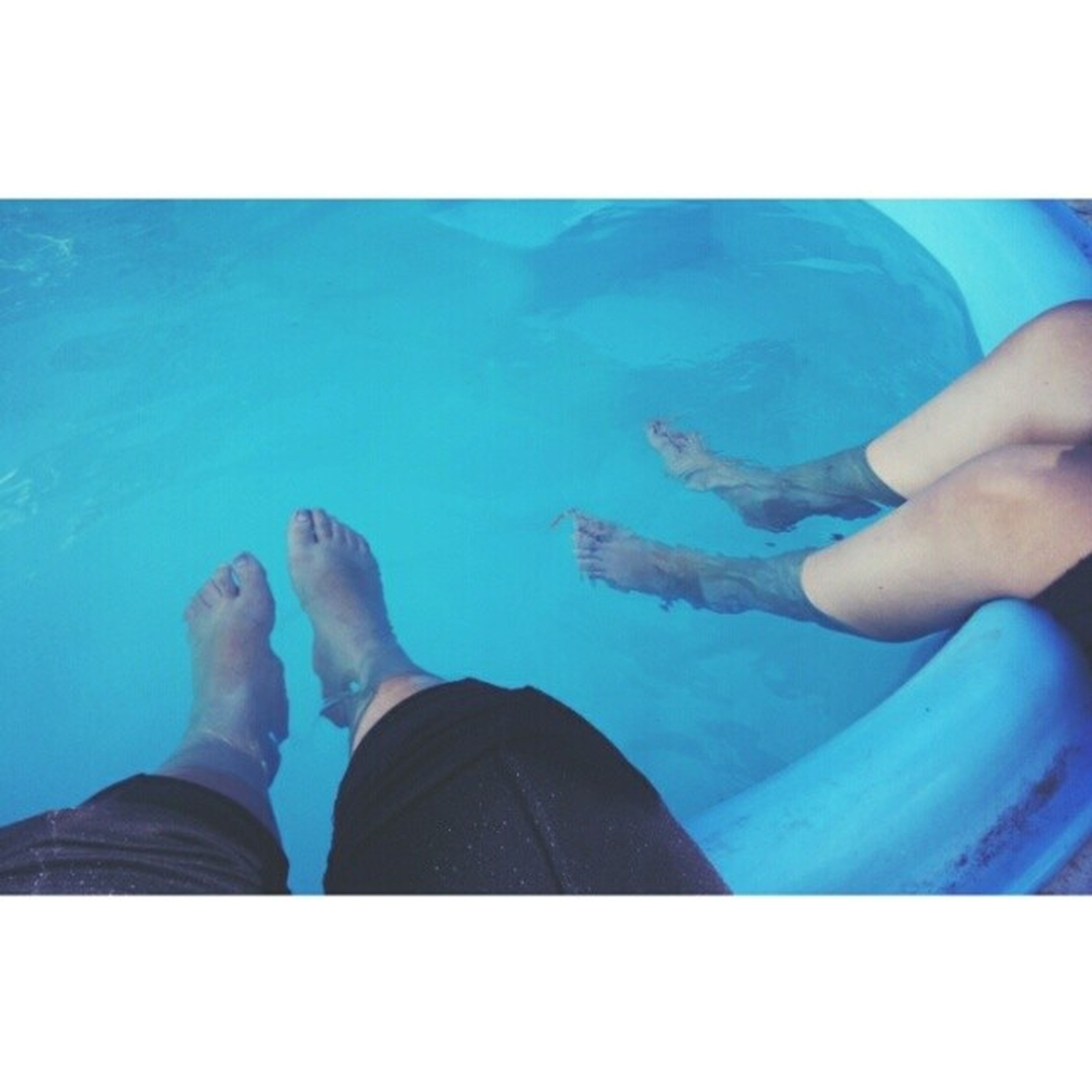 lifestyles, transfer print, leisure activity, low section, person, men, auto post production filter, water, togetherness, personal perspective, blue, relaxation, standing, sitting, human foot