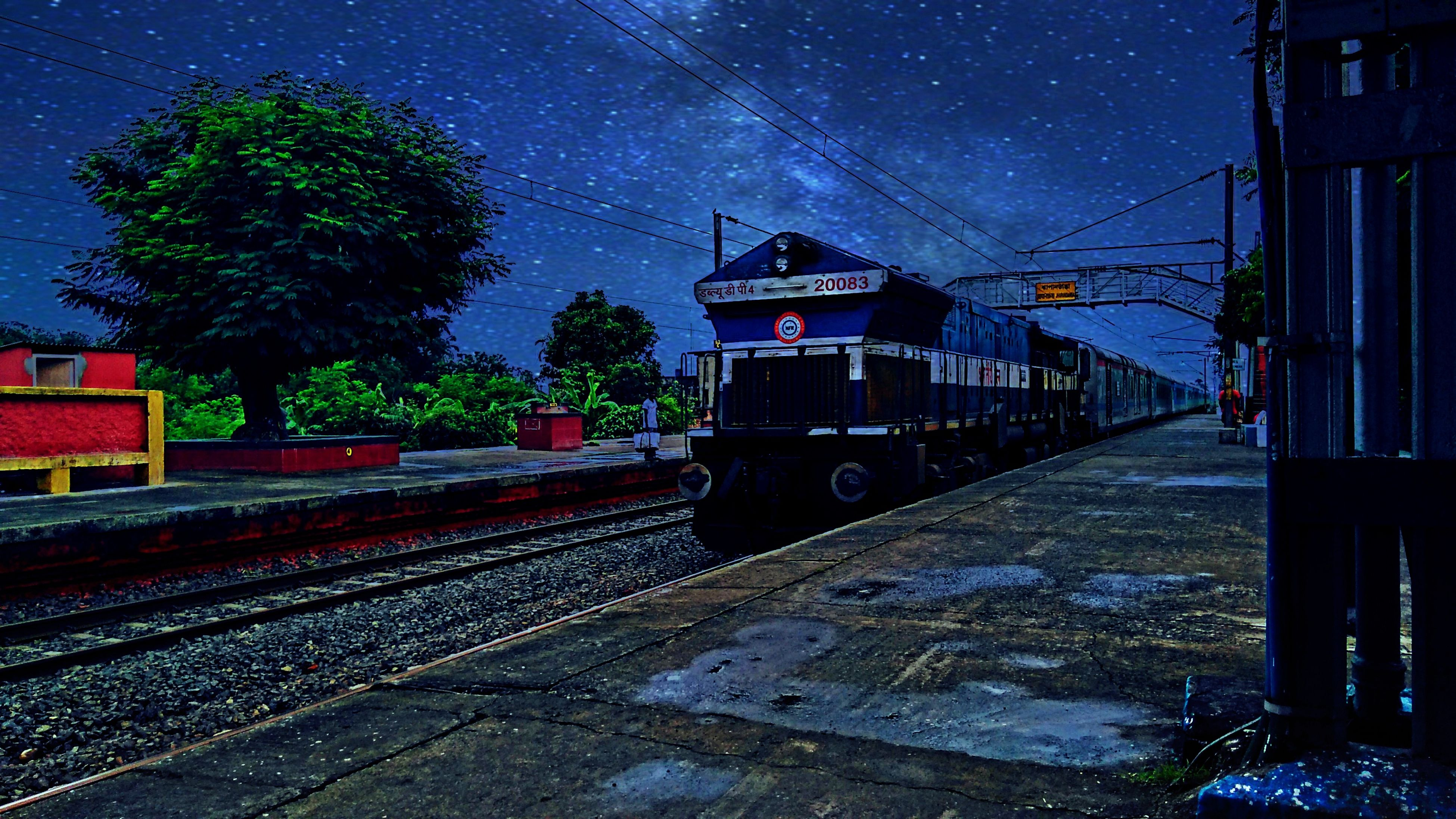 railroad track, night, built structure, sky, illuminated, architecture, the way forward, blue, outdoors, no people, diminishing perspective, cloud - sky, vanishing point, cable