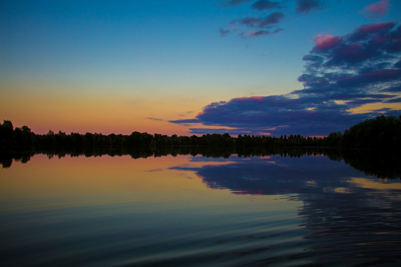 sunset, reflection, water, scenics, beauty in nature, nature, lake, sky, tranquil scene, tranquility, outdoors, waterfront, silhouette, cloud - sky, no people, tree, travel destinations, day