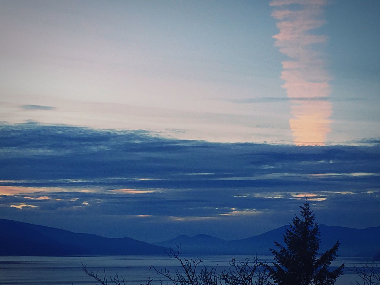 scenics, sky, nature, tranquil scene, beauty in nature, tranquility, sunset, mountain, cloud - sky, no people, silhouette, outdoors, idyllic, landscape, tree, mountain range, winter, sea, water, cold temperature, day