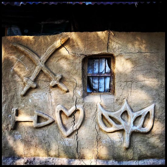 Wall Art in a village. Dhaka. Bangladesh. Photo: sujanmap. Wall Art Work window Mud House sujanmap Photooftheday photographer Wall Sculpture IPhoneography iphoneonly Hello World
