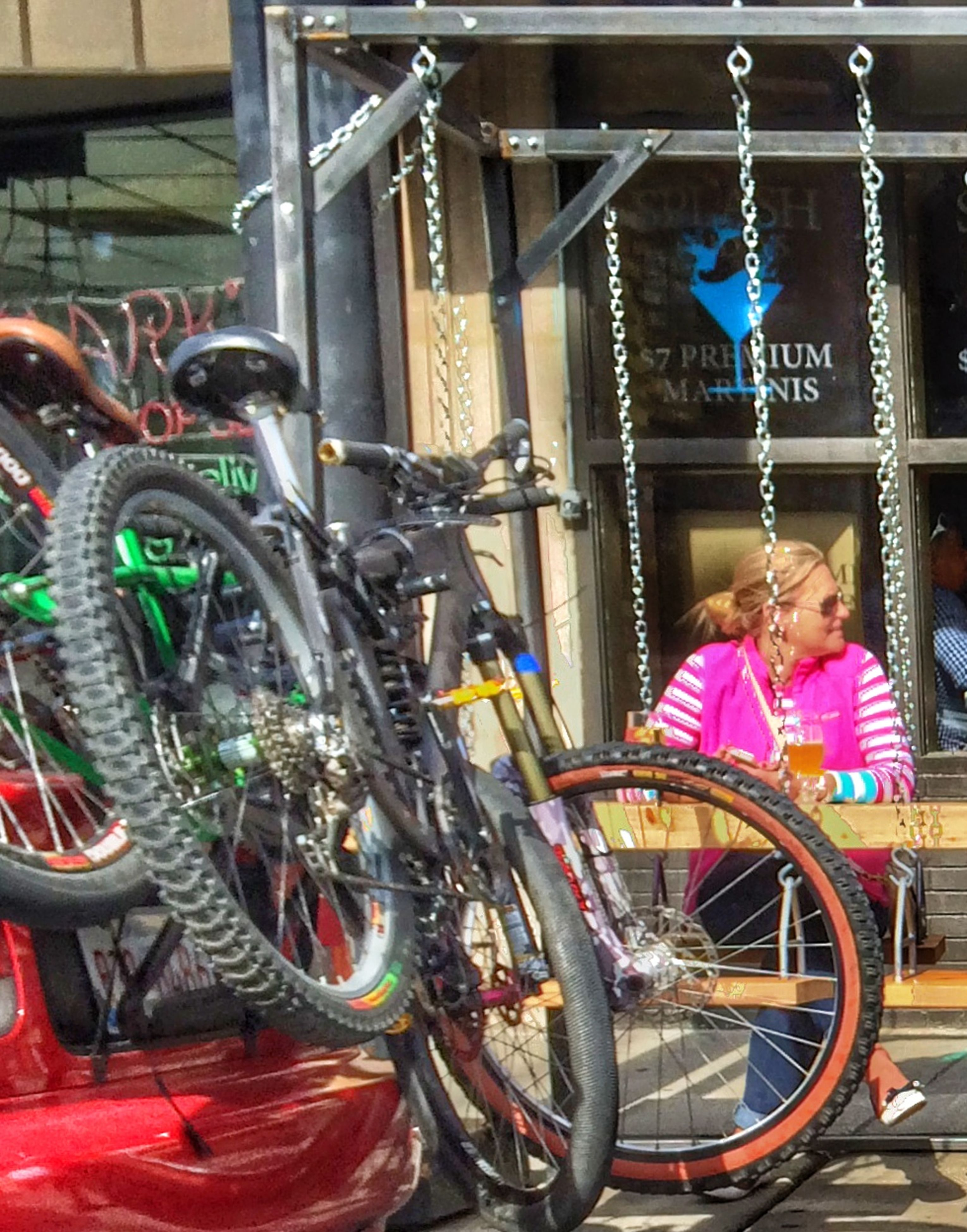 bicycle, mode of transport, transportation, land vehicle, stationary, parking, parked, wheel, travel, outdoors, day, built structure, no people, railing, multi colored, leaning, incidental people, architecture, metal, street
