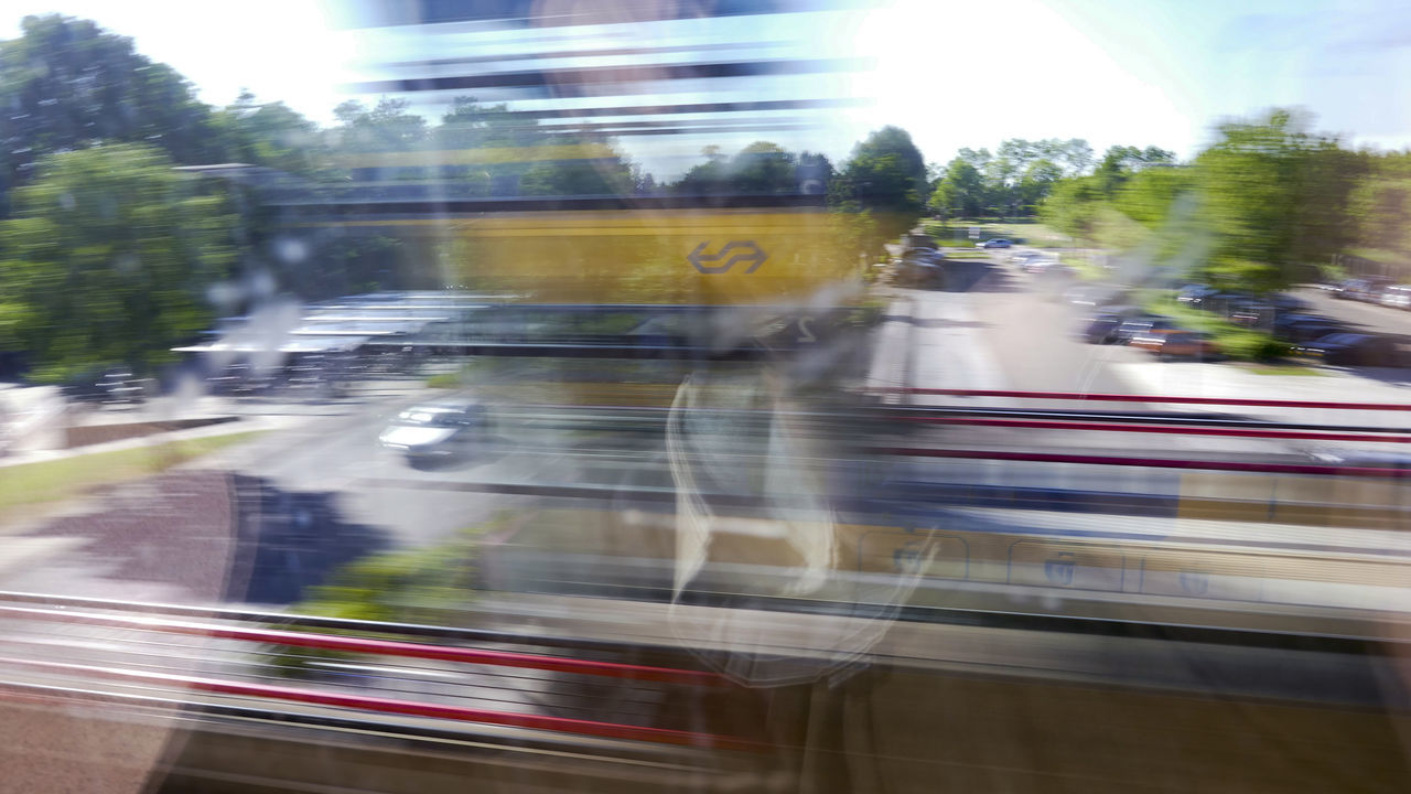 A nice high speed photo from the train. The NS logo is reflected in the window. Architecture Blurred Motion City Day Defocused Motion Netherlands No People Ns Outdoors Speed Train Train Station Transportation Tree