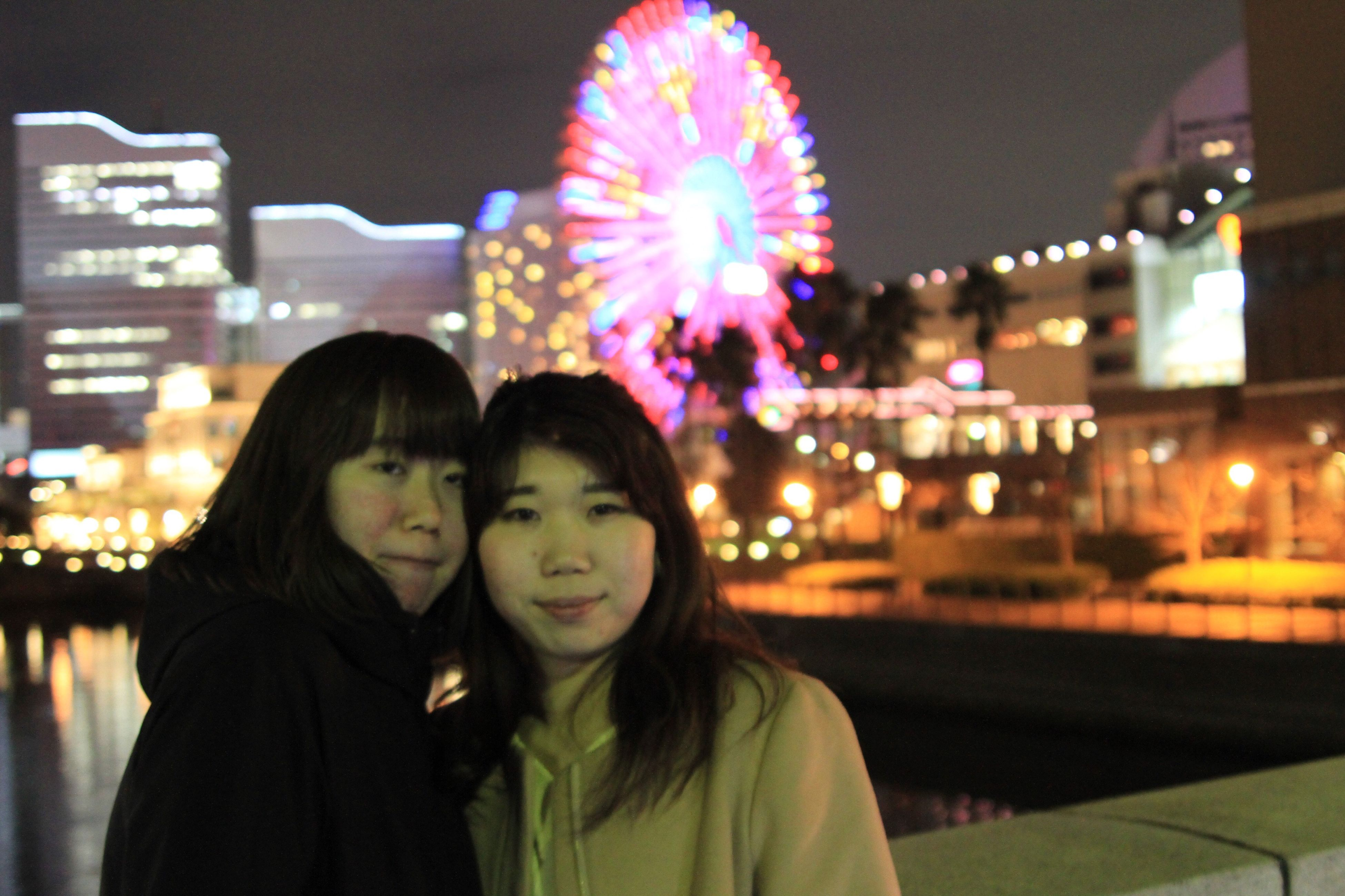 two people, night, illuminated, togetherness, real people, lifestyles, women, bonding, leisure activity, happiness, city, nightlife, smiling, people, neon, outdoors, adult