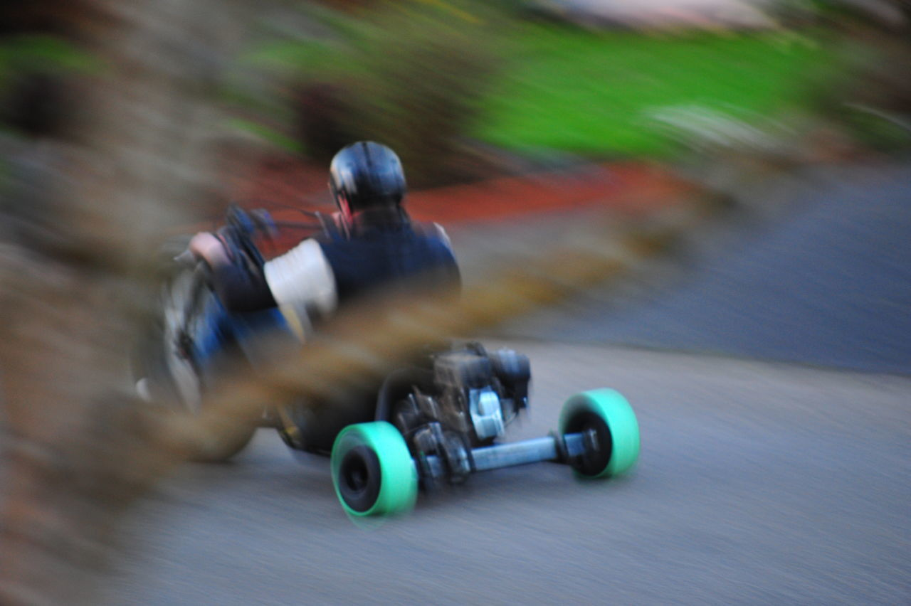 Adventure Auto Racing Blurred Motion Competition Crash Helmet Day Driving Helmet Land Vehicle Lifestyles Mode Of Transport Motion Motor Racing Track Motorcycle Motorcycle Racing Motorsport Outdoors Racecar Real People Speed Sport Sports Clothing Sports Race Sports Track Unrecognizable Person