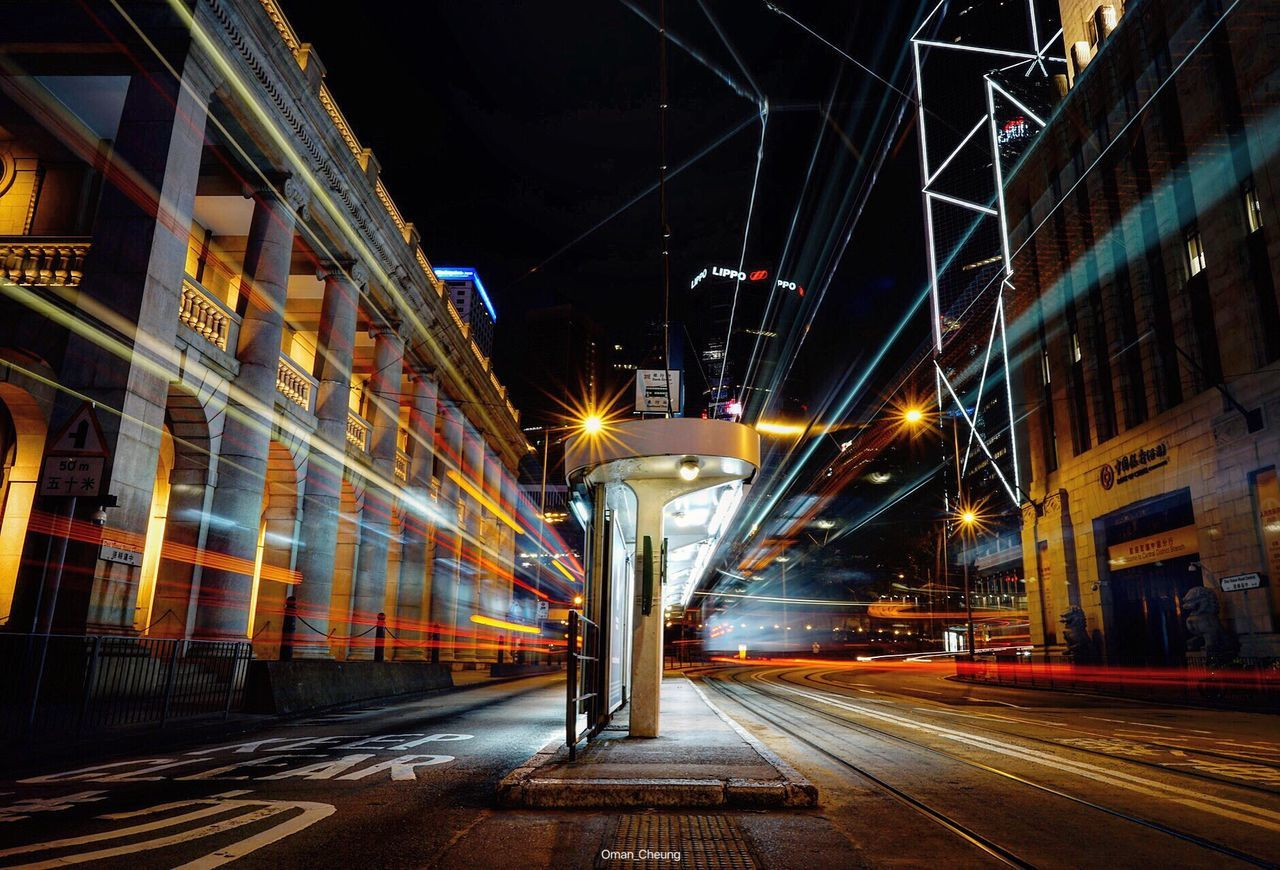 Light Trails On Street Amidst Buildings In City