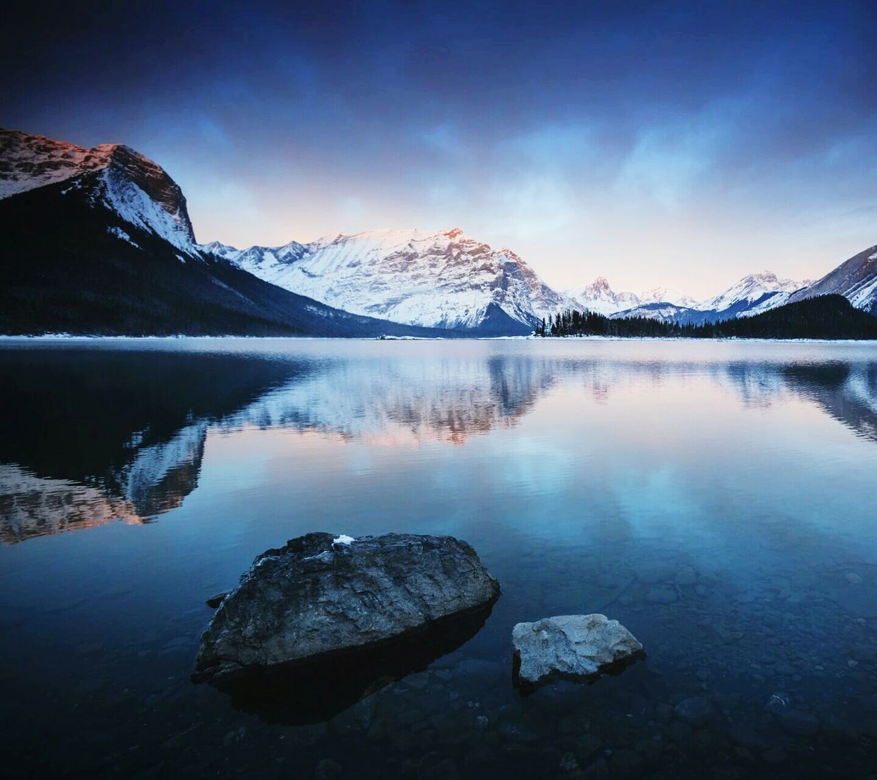 mountain, lake, scenics, water, mountain range, snow, beauty in nature, reflection, tranquil scene, nature, cold temperature, majestic, tranquility, winter, idyllic, snowcapped mountain, no people, sky, rock - object, outdoors, mountain peak, travel destinations, frozen, rocky mountains, landscape, day, iceberg