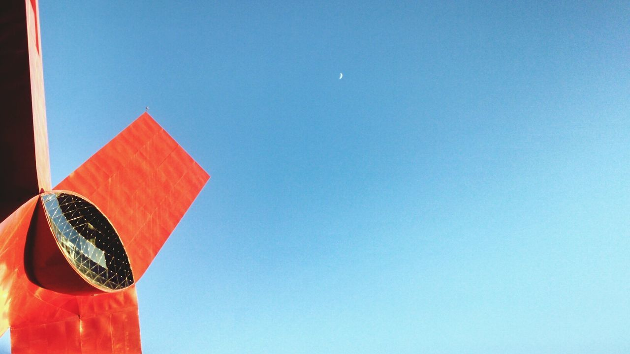 copy space, blue, clear sky, low angle view, no people, red, day, moon, outdoors, road sign, sky, close-up