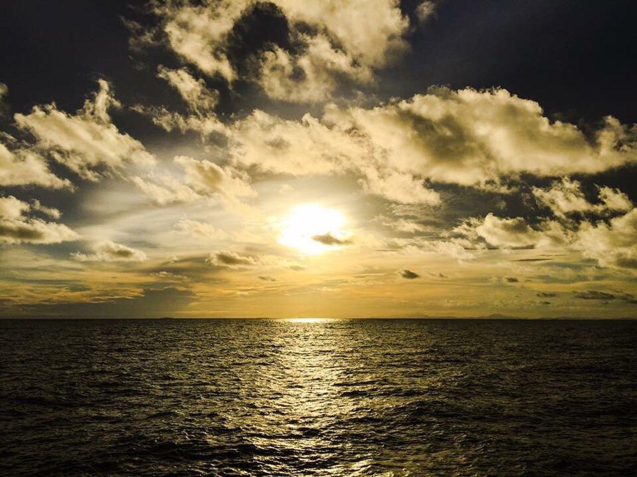 sea, freedom, sunset, idyllic, sun, beauty in nature, tranquil scene, scenics, sunbeam, nature, tranquility, water, horizon over water, sunlight, no people, sky, landscape, outdoors