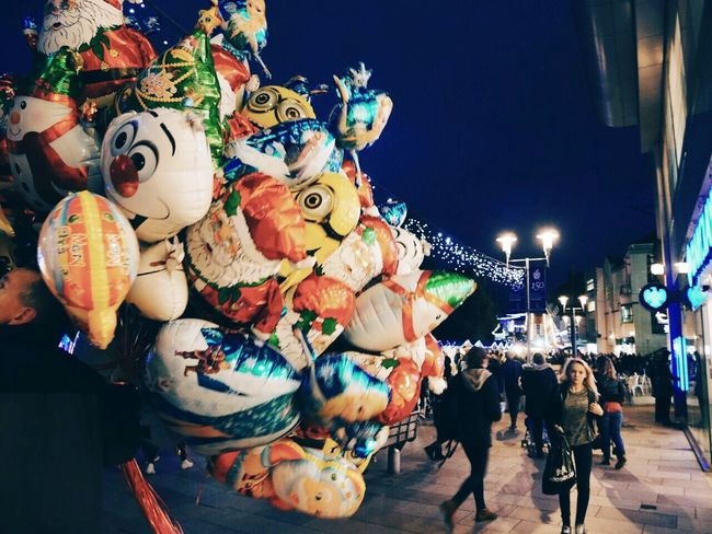 The Culture Of The Holidays Happy Holidays❤ Christmas Market Christmas Lights Baloons Street Night City Street Christmas Lights!  Illuminated Walking Around