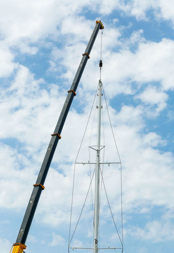 Crane is installing a mast on the yacht Backgrounds Bodrum Crane High Install Installing Luxury Marine Mast Sailing Sails Sea Port Ship Ship Building Sky Tower Turkey Vessel Work Yacht Yachting