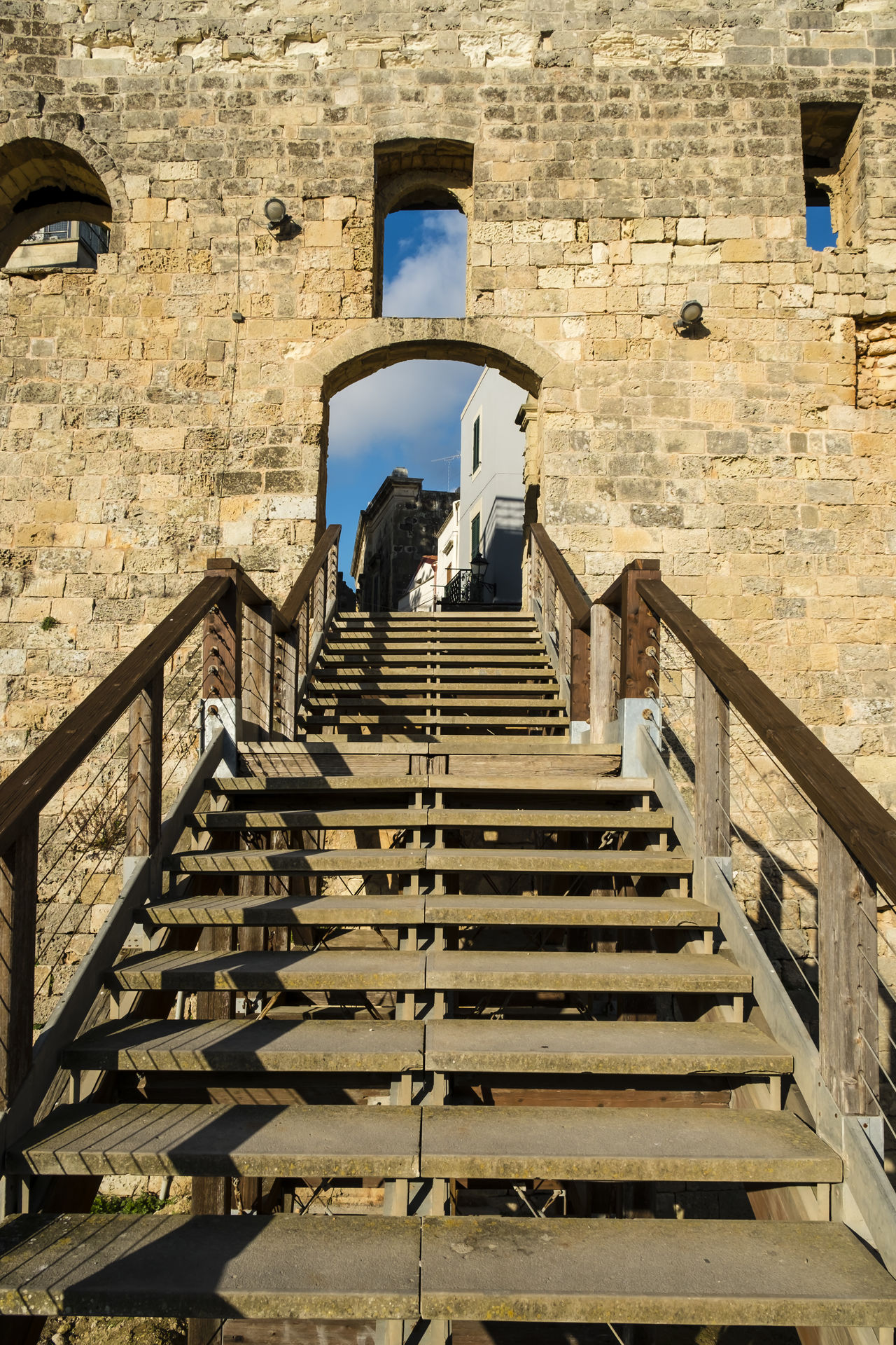 Adult Ancient Architecture Castle Climbing Day Entrance Entrance Gate Italy Lifestyles Men One Person Otranto Outdoors People Puglia Railing Real People Rear View Salento Sky Staircase Steps Steps And Staircases Wood