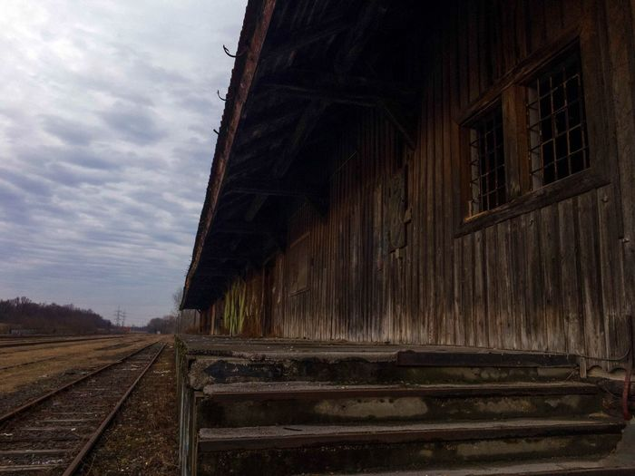 Railroad Track Rail Transportation Building Architecture No People Sky Outdoors Cloud - Sky Day The Way Forward Vanishing Point Deterioration Public Transportation Iphone6s Iphonephotography IPhoneography The Architect - 2017 EyeEm Awards