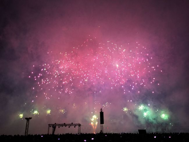 Celebration Entertainment Event Exploding Firework - Man Made Object Firework Display Glowing Illuminated Low Angle View Majestic Motion Multi Colored Night No People Outdoors Pink Color Red Sky Sparks Tourism