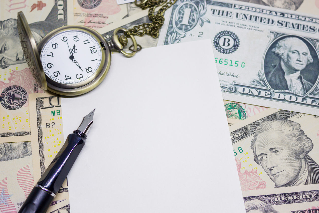 fountain pen, empty paper and classic pocket watch on dollar banknote, concept and idea of time value and money, business and finance concepts. Currency Day Dollar Finance Financial Ink Large Group Of Objects Money Paper Paper Currency Pen Wealth