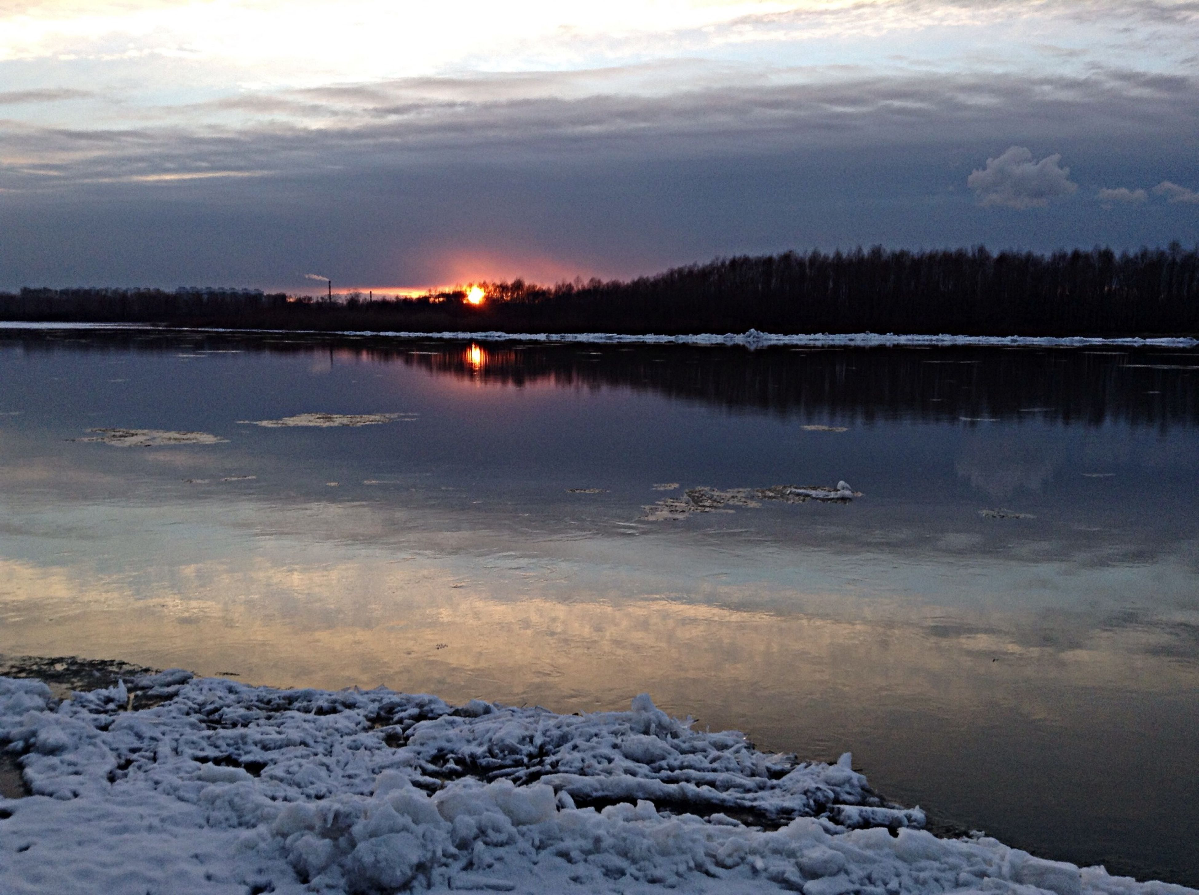 water, snow, cold temperature, winter, tranquil scene, bird, scenics, sunset, tranquility, beauty in nature, lake, animal themes, sky, nature, reflection, wildlife, animals in the wild, weather, silhouette, cloud - sky