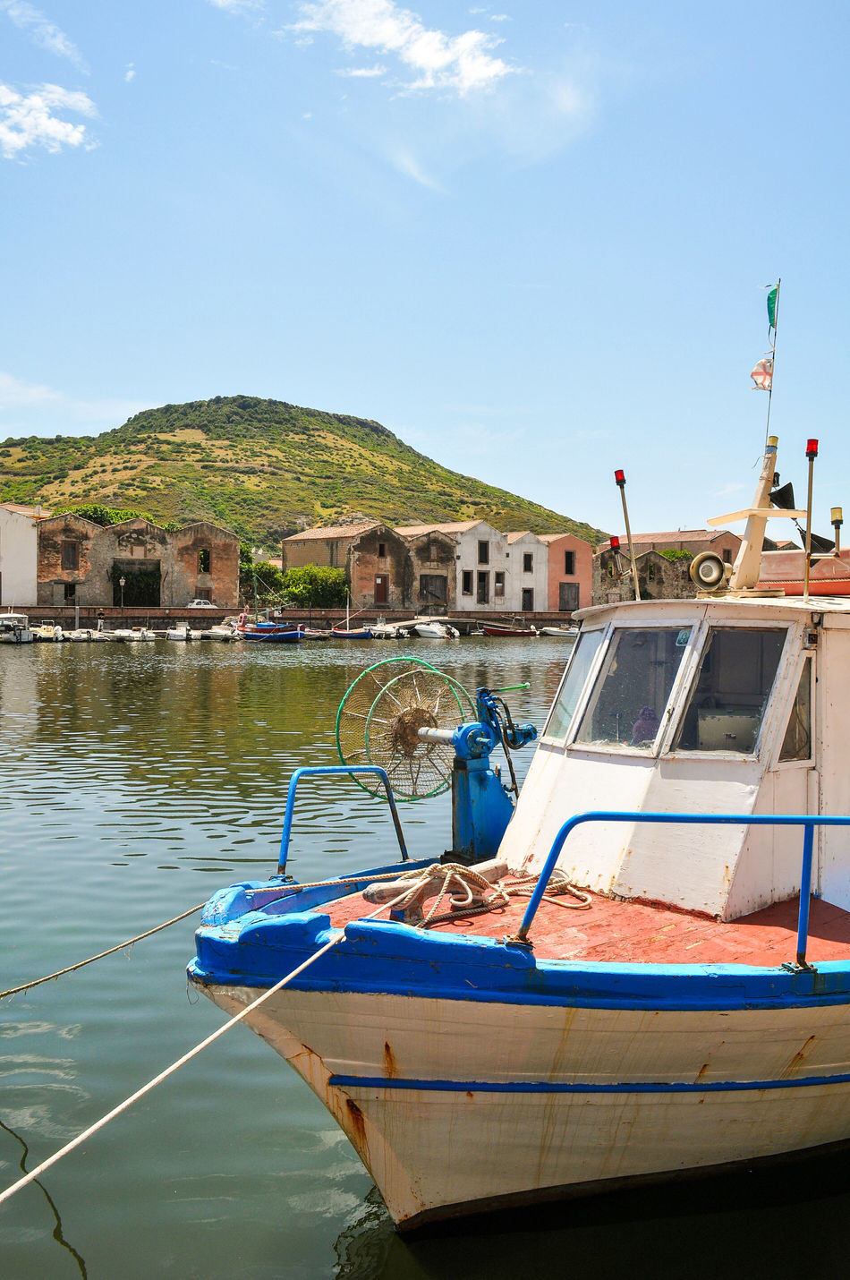 Water Nautical Vessel Reflection Blue Waterfront Outdoors No People City Day Sky Cityscape Architecture River Fishboat Fishermen Houses Vertical Shot Sardinia Sardegna Italy